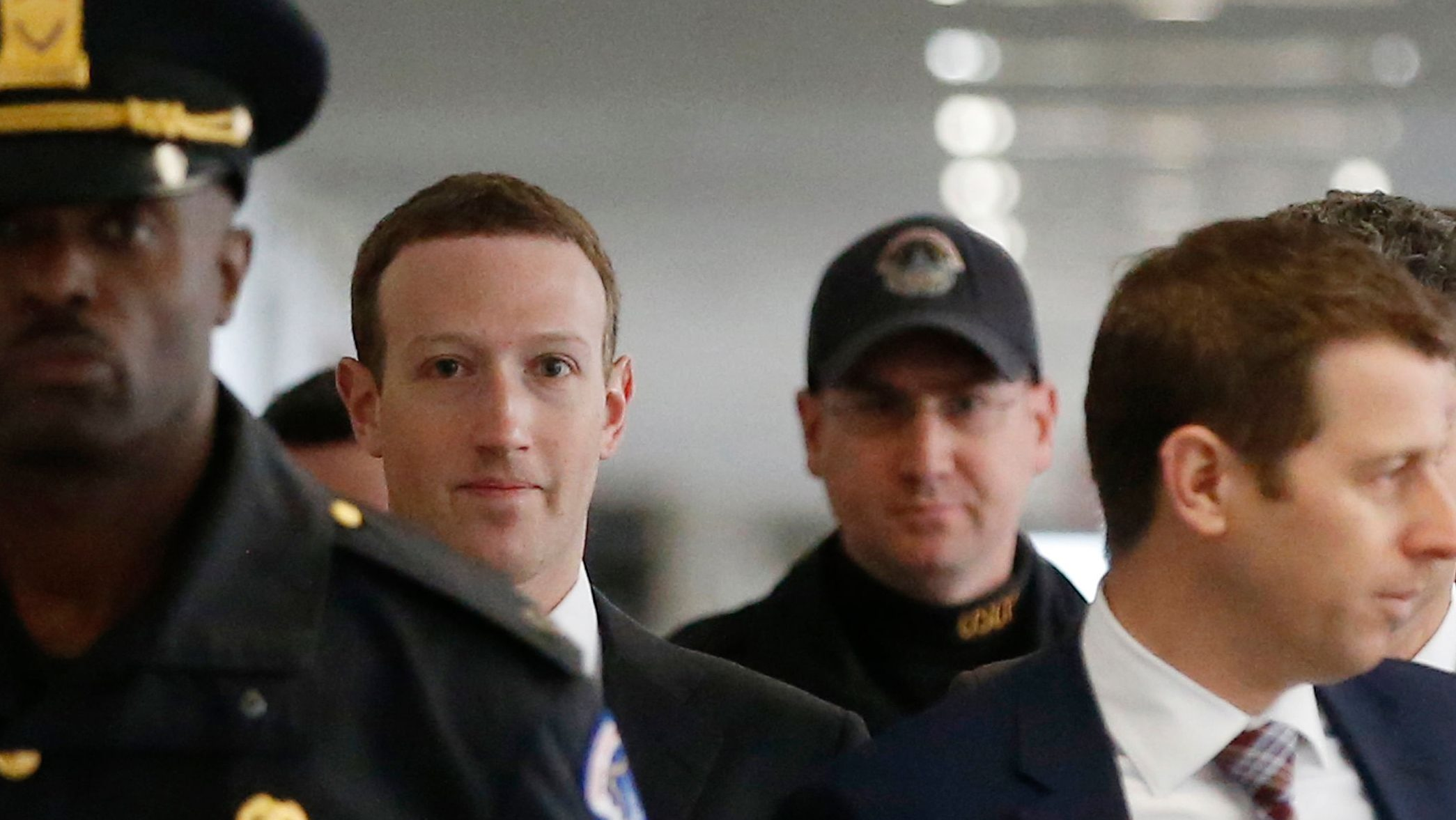 Facebook CEO Mark Zuckerberg arrives for a meeting with Senator Bill Nelson (D-FL) on Capitol Hill in Washington, U.S., April 9, 2018. REUTERS/Leah Millis - HP1EE491BXQ44