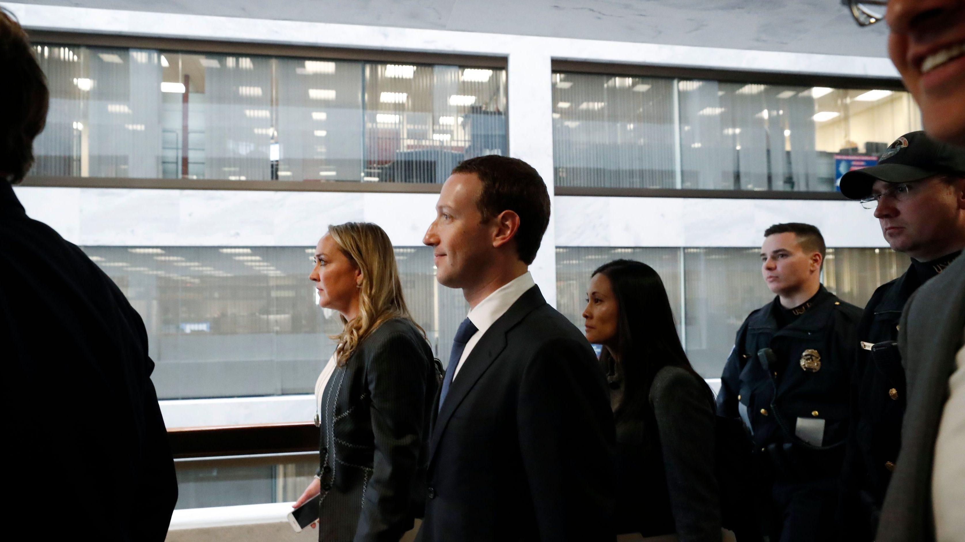 Facebook CEO Mark Zuckerberg walks to a meeting with Senator John Thune (R-SD) on Capitol Hill in Washington, U.S., April 9, 2018. REUTERS/Leah Millis - HP1EE491L124M