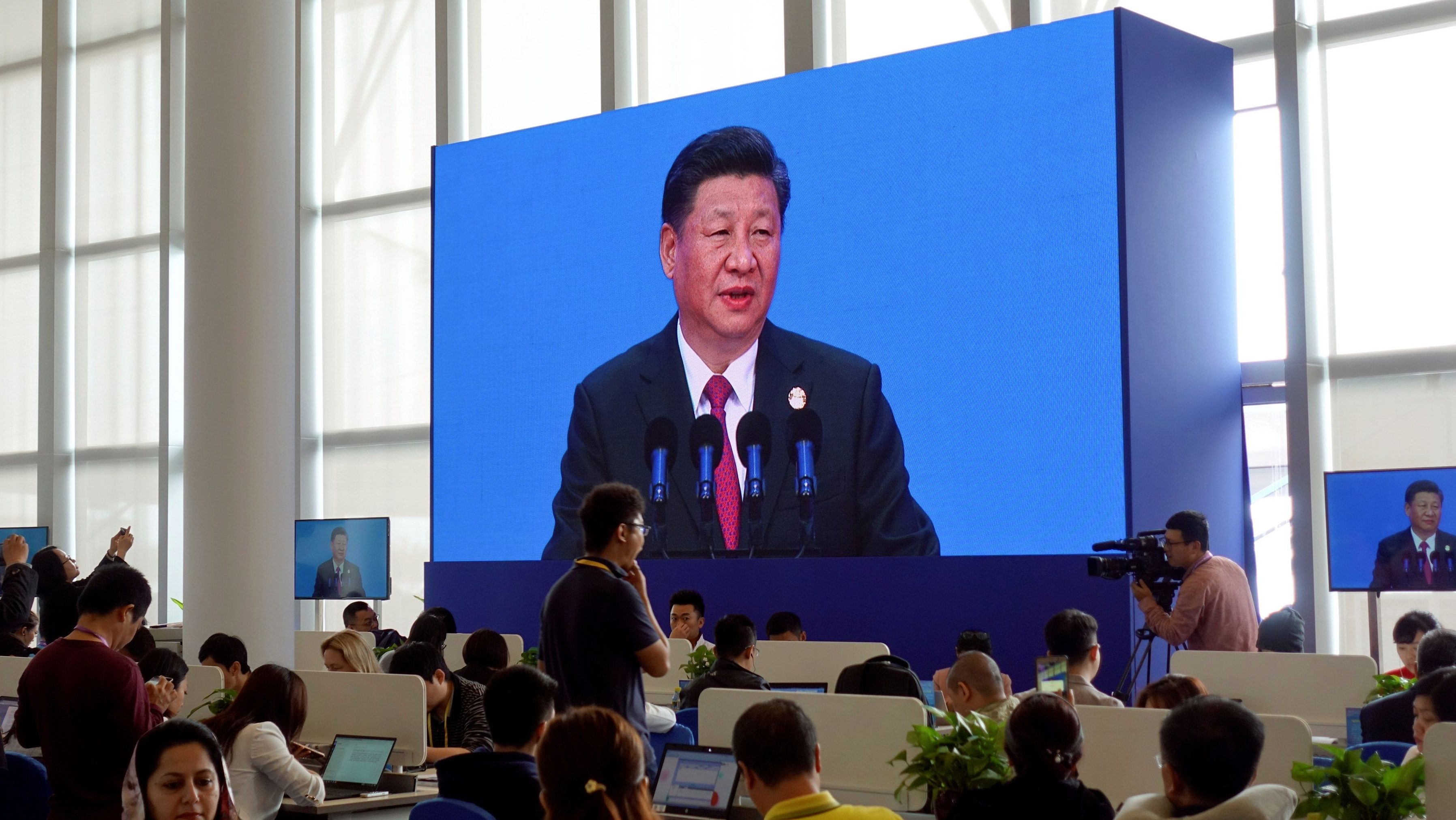 Reporters at media centre of Boao Forum for Asia watch Chinese President Xi Jinping delivering his speech at the annual forum, in Boao