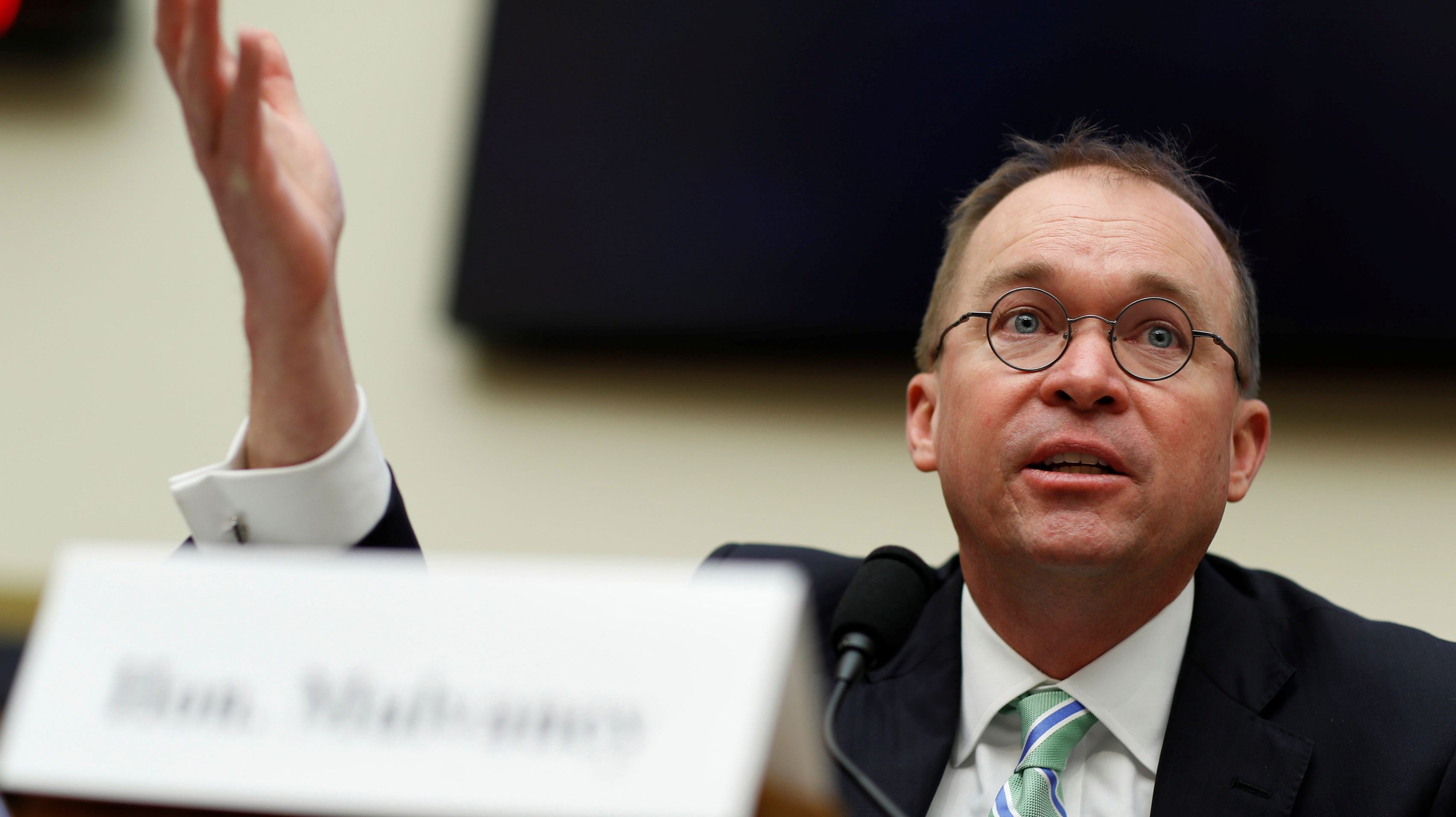 Office of Management and Budget Director Mick Mulvaney, acting CFPB director, testifies before a House Financial Services Committee hearing on the Consumer Financial Protection Bureau's (CFPB) semi-annual report to Congress on Capitol Hill in Washington, U.S., April 11, 2018. REUTERS/Aaron P. Bernstein - RC18329523D0