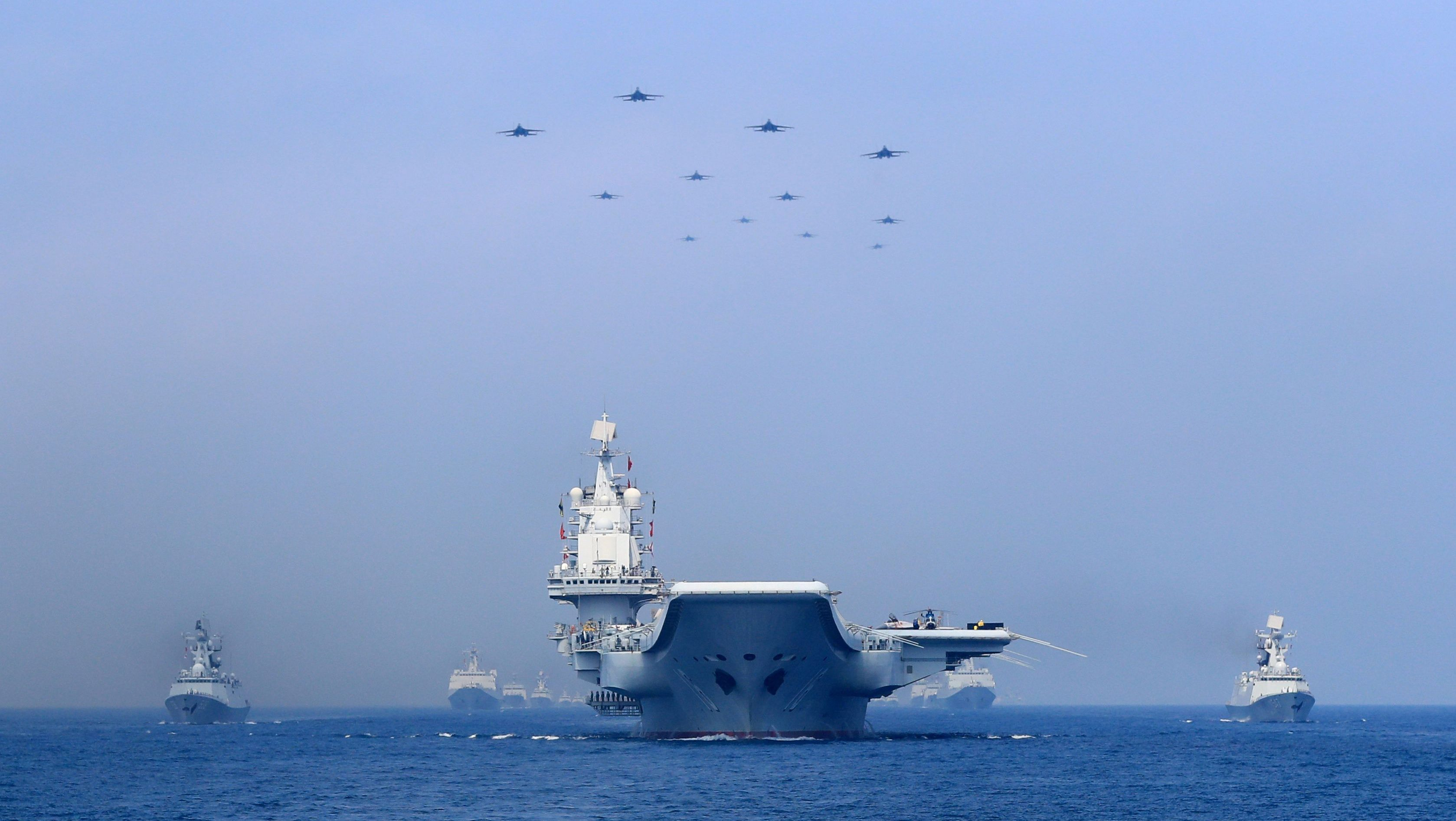 Warships and fighter jets of Chinese People's Liberation Army (PLA) Navy take part in a military display in the South China Sea April 12, 2018.