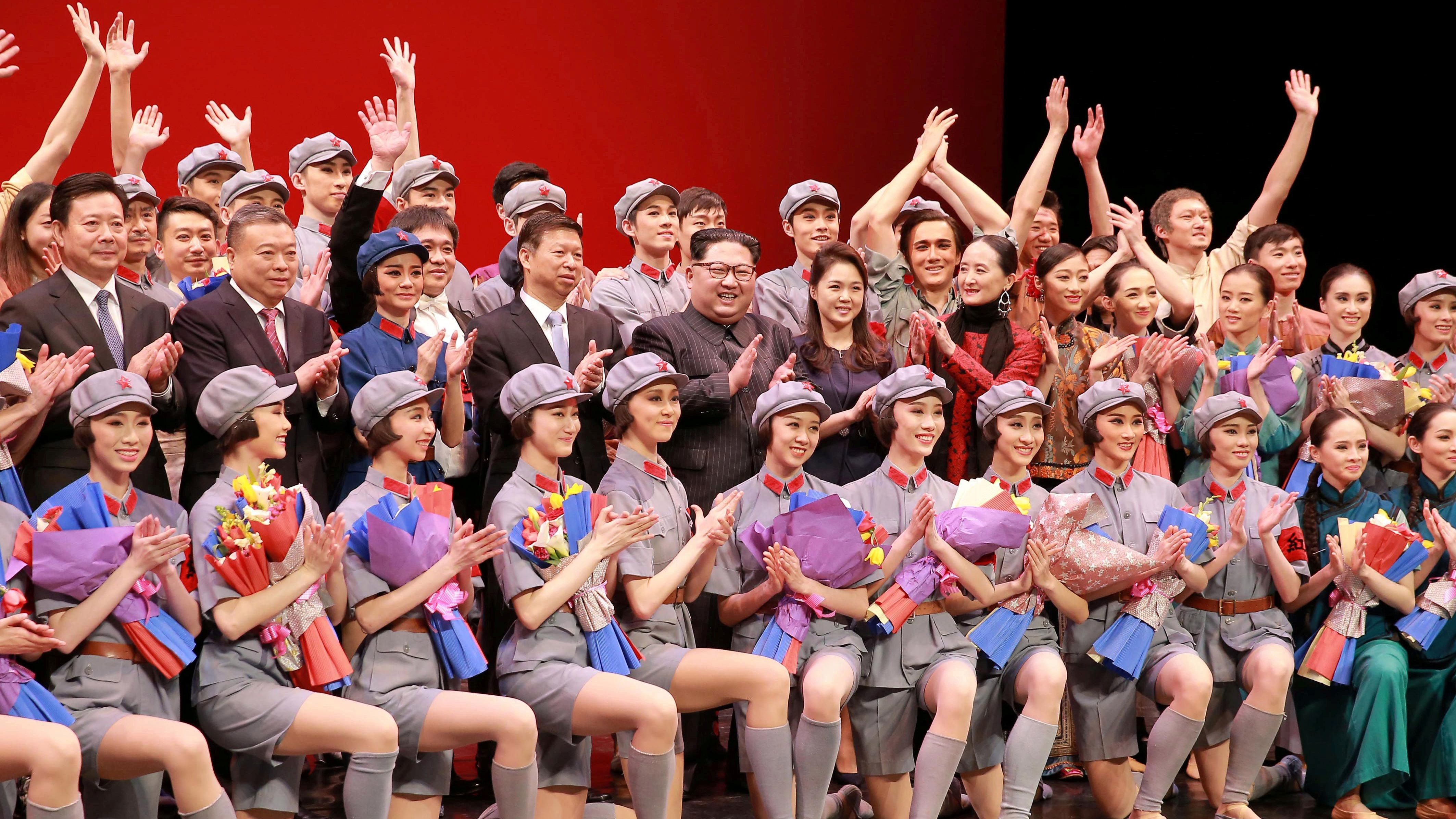 North Korean leader Kim Jong Un, his wife Ri Sol Ju and Song Tao, head of the International Department of Communist Party of China (CPC) Central Committee, applaud with ballet dancers in this undated photo released by North Korea's Korean Central News Agency (KCNA) in Pyongyang April 17, 2018.