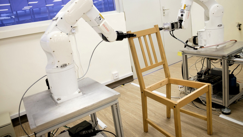 Robots assemble an Ikea chair at Nanyang Technological University (NTU) in Singapore April 17, 2018.