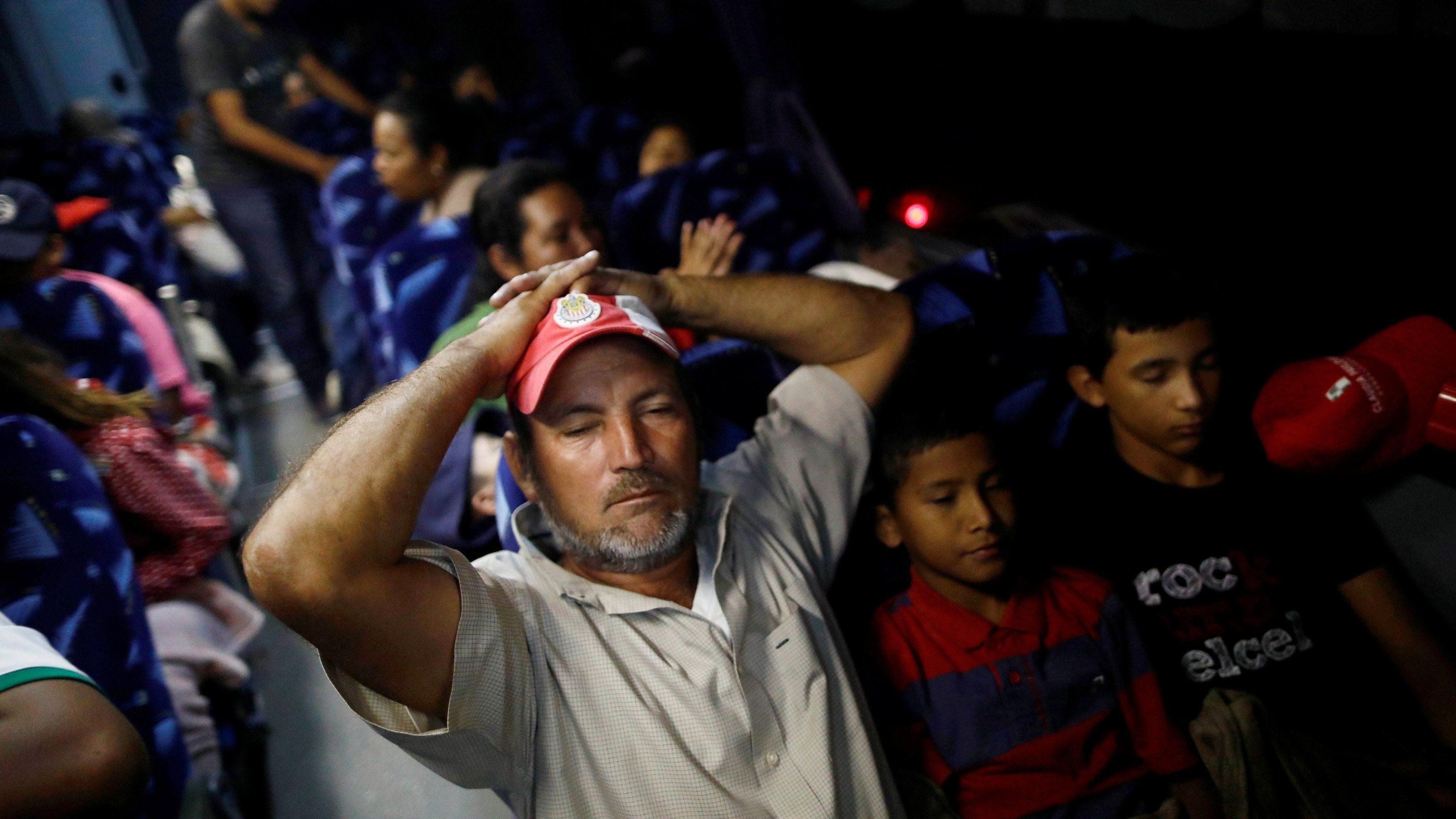A Central American migrant, moving in a caravan through Mexico