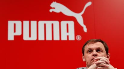 FILE PHOTO: Bjoern Gulden, CEO of German sports goods firm Puma, attends the company's annual news conference in Herzogenaurach February 20, 2014. REUTERS/Michaela Rehle/File Photo - RC1604329A20