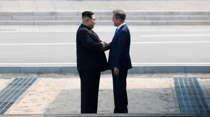 South Korean President Moon Jae-in and North Korean leader Kim Jong Un meet in the truce village of Panmunjom inside the demilitarized zone separating the two Koreas, South Korea, April 27, 2018.
