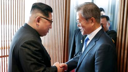South Korean President Moon Jae-in shakes hands with North Korean leader Kim Jong Un at the truce village of Panmunjom inside the demilitarized zone separating the two Koreas, South Korea, April 27, 2018.