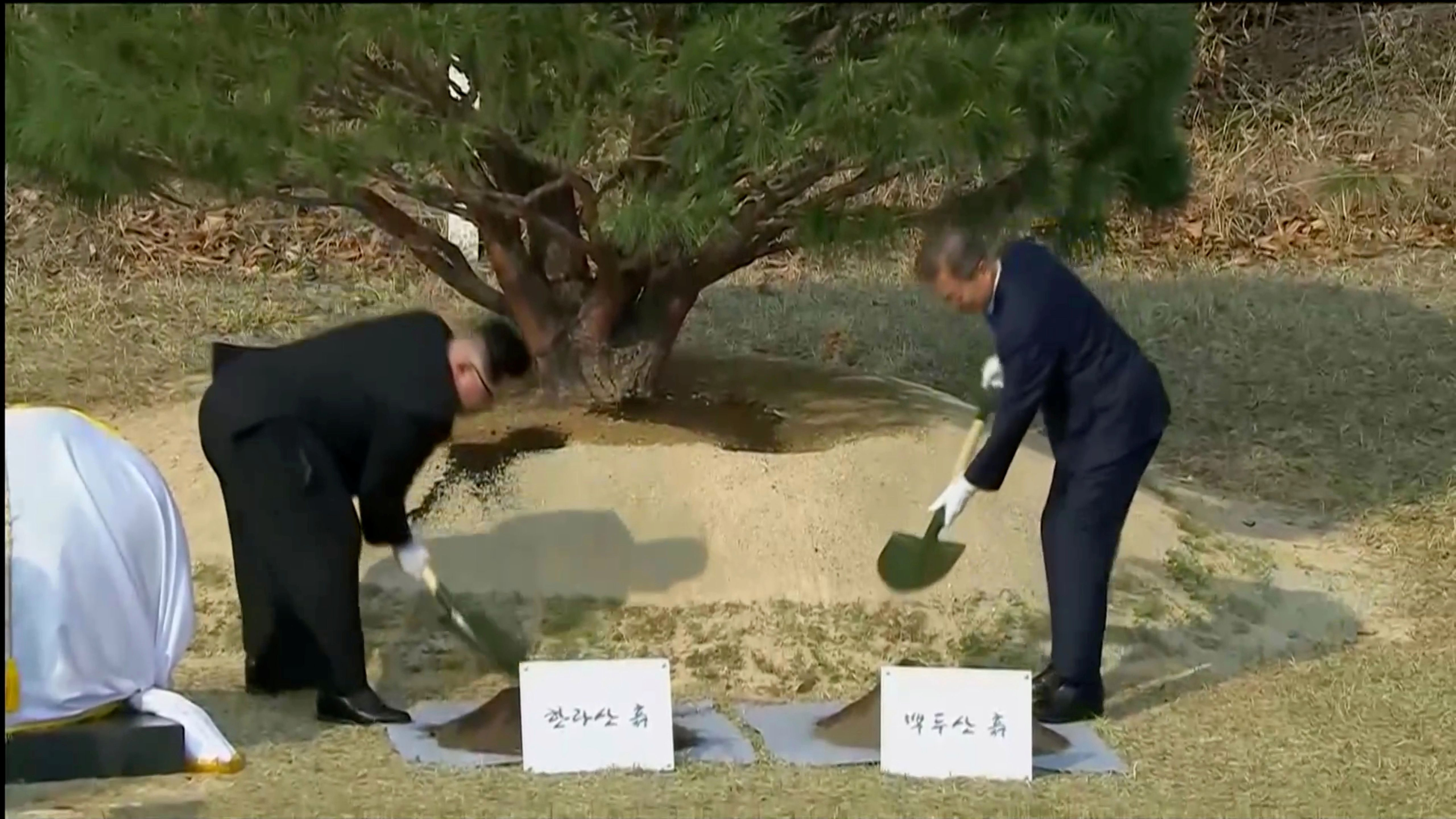 South Korean President Moon Jae-in and North Korean leader Kim Jong Un attend tree planting ceremony during the inter-Korean summit at the truce village of Panmunjom, in this still frame taken from video, South Korea April 27, 2018. Host Broadcaster via REUTERS TV  ATTENTION EDITORS - THIS IMAGE HAS BEEN PROVIDED BY A THIRD PARTY. NO RESALES. NO ARCHIVES. SOUTH KOREA OUT. - RC118EEE7730