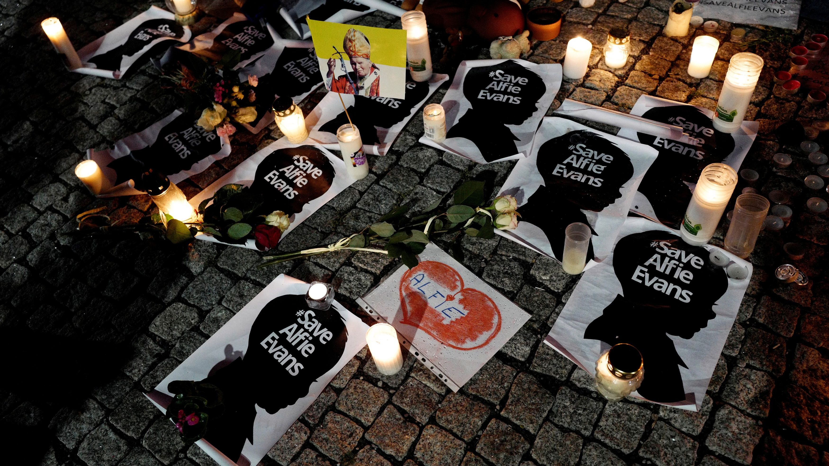 Candles and placards are pictured during a protest in support of Alfie Evans, in front of the British embassy building in Warsaw, Poland, on April 26, 2018.