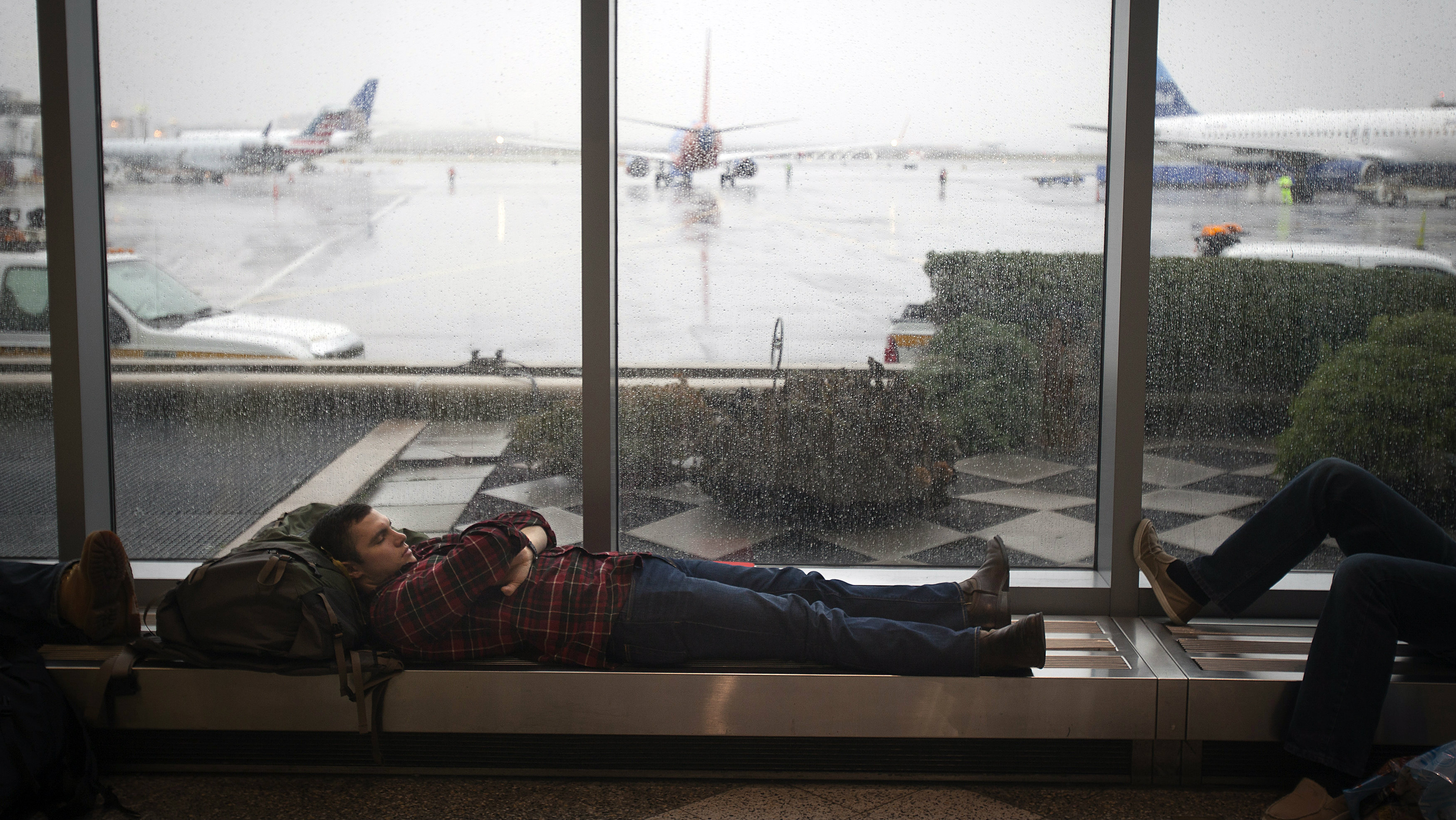 Man sleeping at airport gate