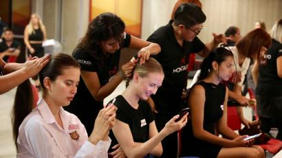 Models backstage getting their hair done at Fashion Week in Lima, Peru.