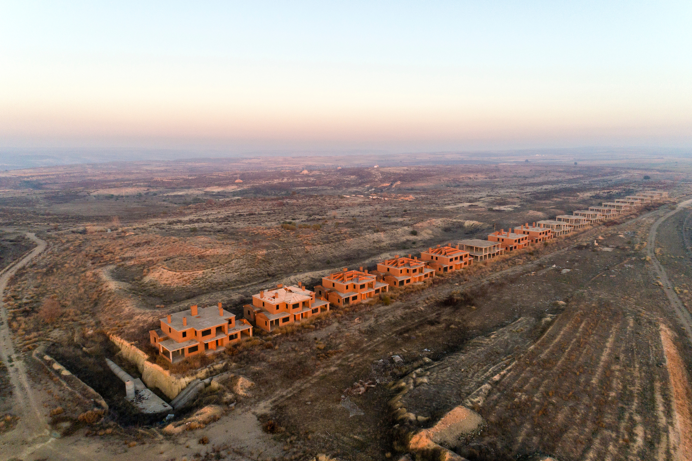 spain_drone_01 An aerial view of a partially built housing development. (Markel Redondo)