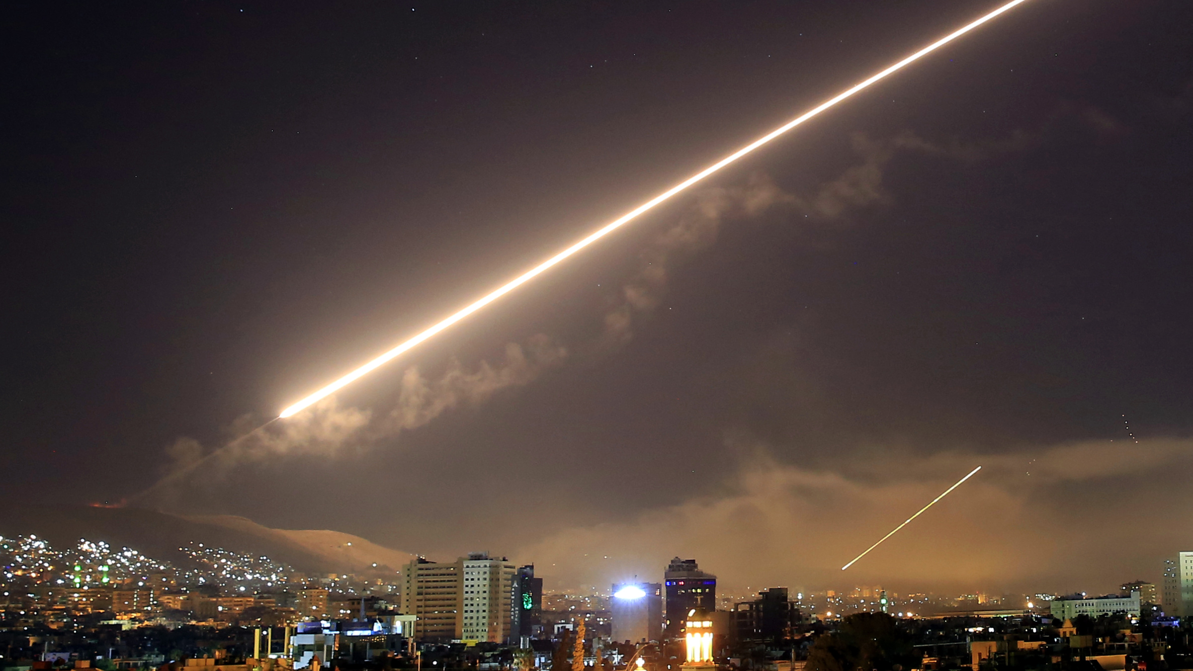 Damascus skies erupt with surface to air missile fire as the U.S. launches an attack on Syria targeting different parts of the Syrian capital Damascus, Syria, early Saturday, April 14, 2018. Syria's capital has been rocked by loud explosions that lit up the sky with heavy smoke as U.S. President Donald Trump announced airstrikes in retaliation for the country's alleged use of chemical weapons.