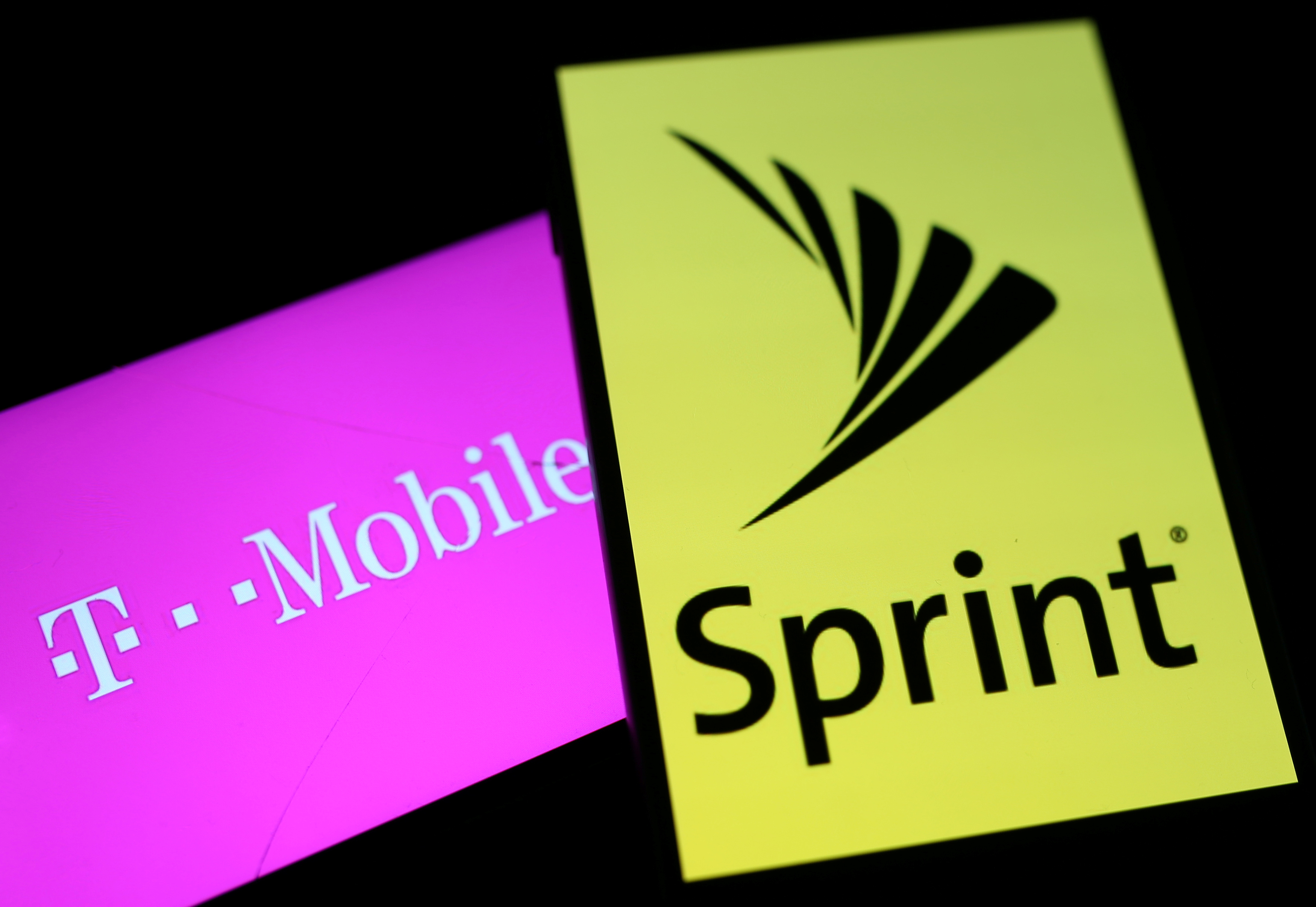 Smartphones with the logos of T-Mobile and Sprint are seen in this illustration taken September 19, 2017.