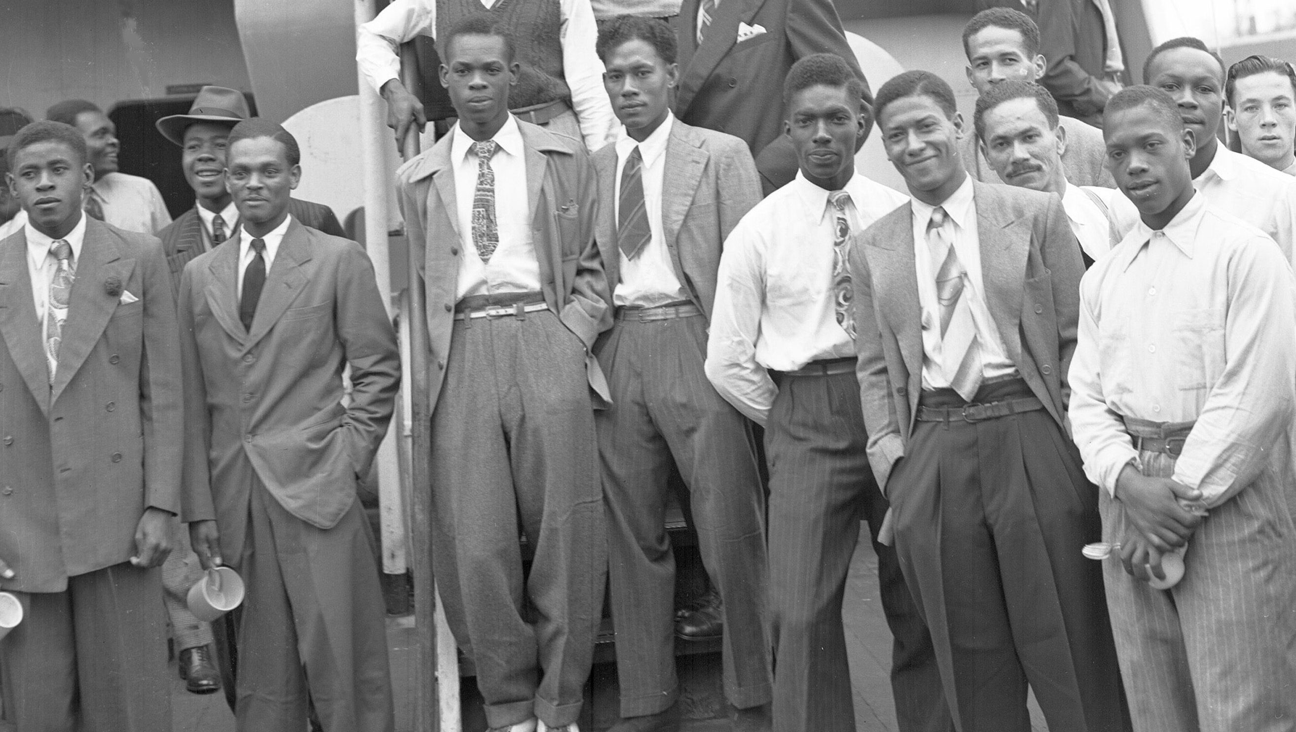 Some of the Jamaican men, mostly ex Royal Air Force servicemen, aboard the former troopship, S.S. Empire Windrush, before disembarking at Tilbury Docks, England, on June 22, 1948. They have come to Britain seeking employment.