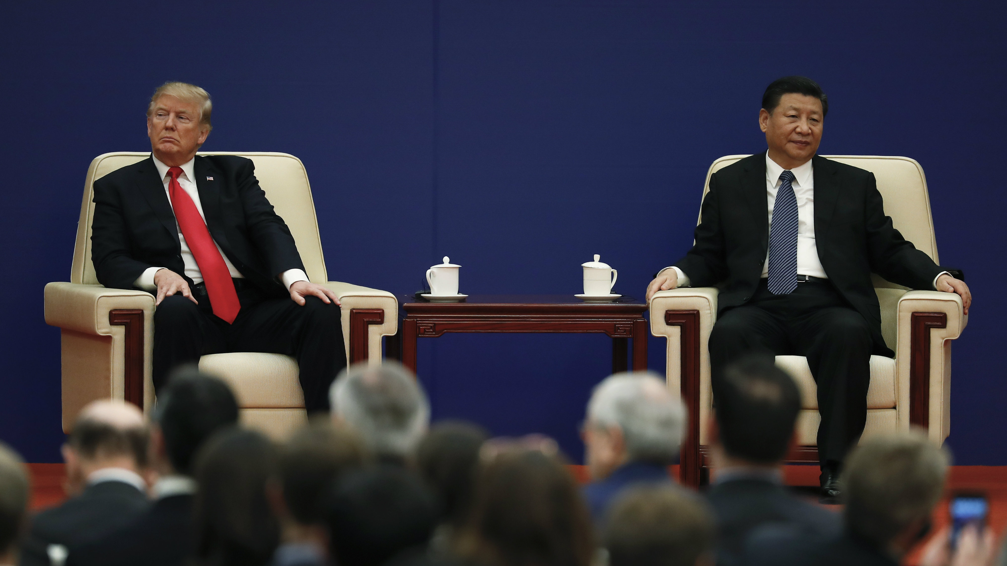 U.S. President Donald Trump, left, and Chinese President Xi Jinping attend a business event at the Great Hall of the People in Beijing, Thursday, Nov. 9, 2017. Trump is on a five-country trip through Asia traveling to Japan, South Korea, China, Vietnam and the Philippines.