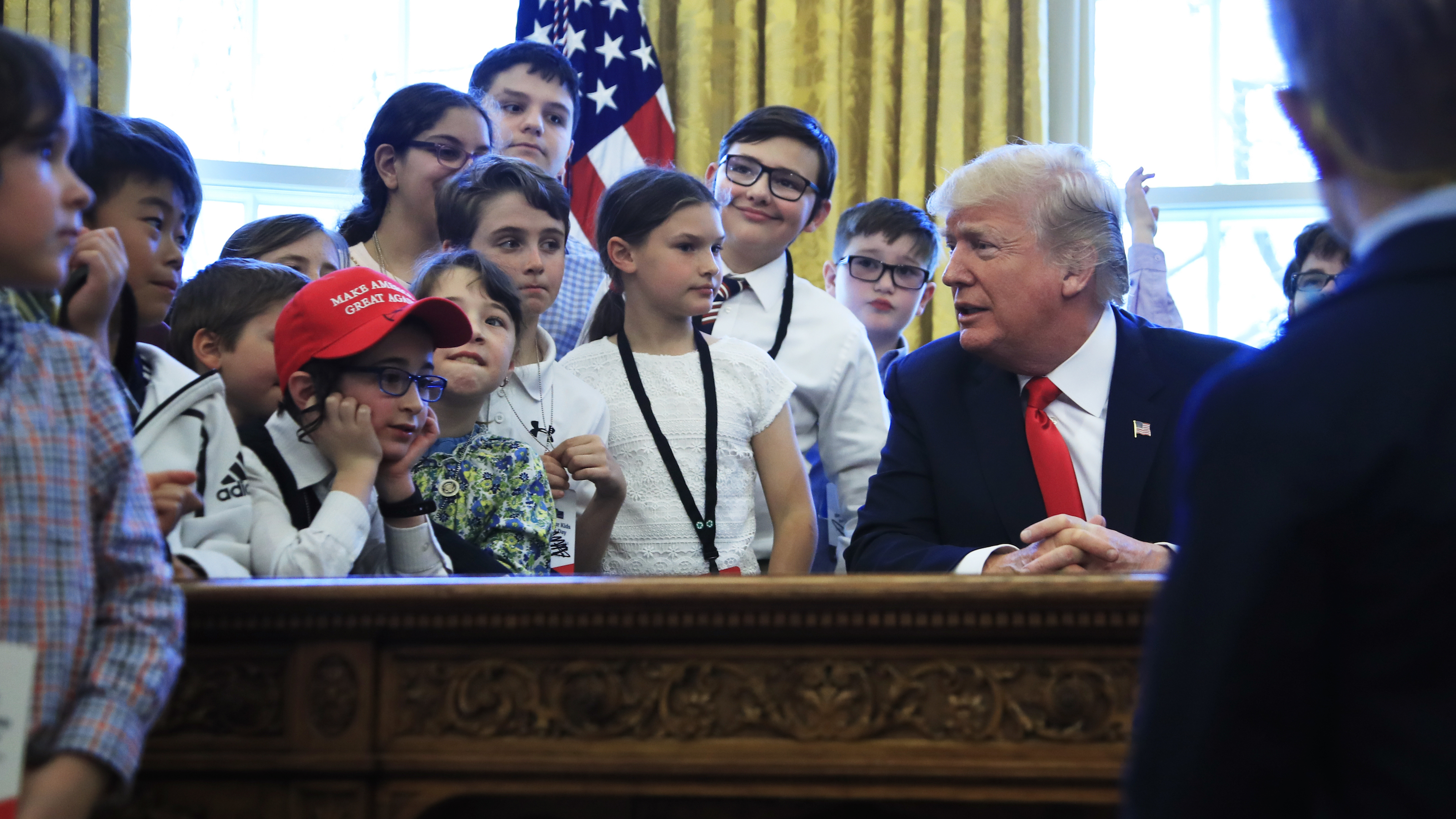 "President Donald Trump talks to children in the Oval Office in celebration of ""Bring Our Daughters and Sons to Work Day"" at the White House in Washington, Thursday, April 26, 2018."
