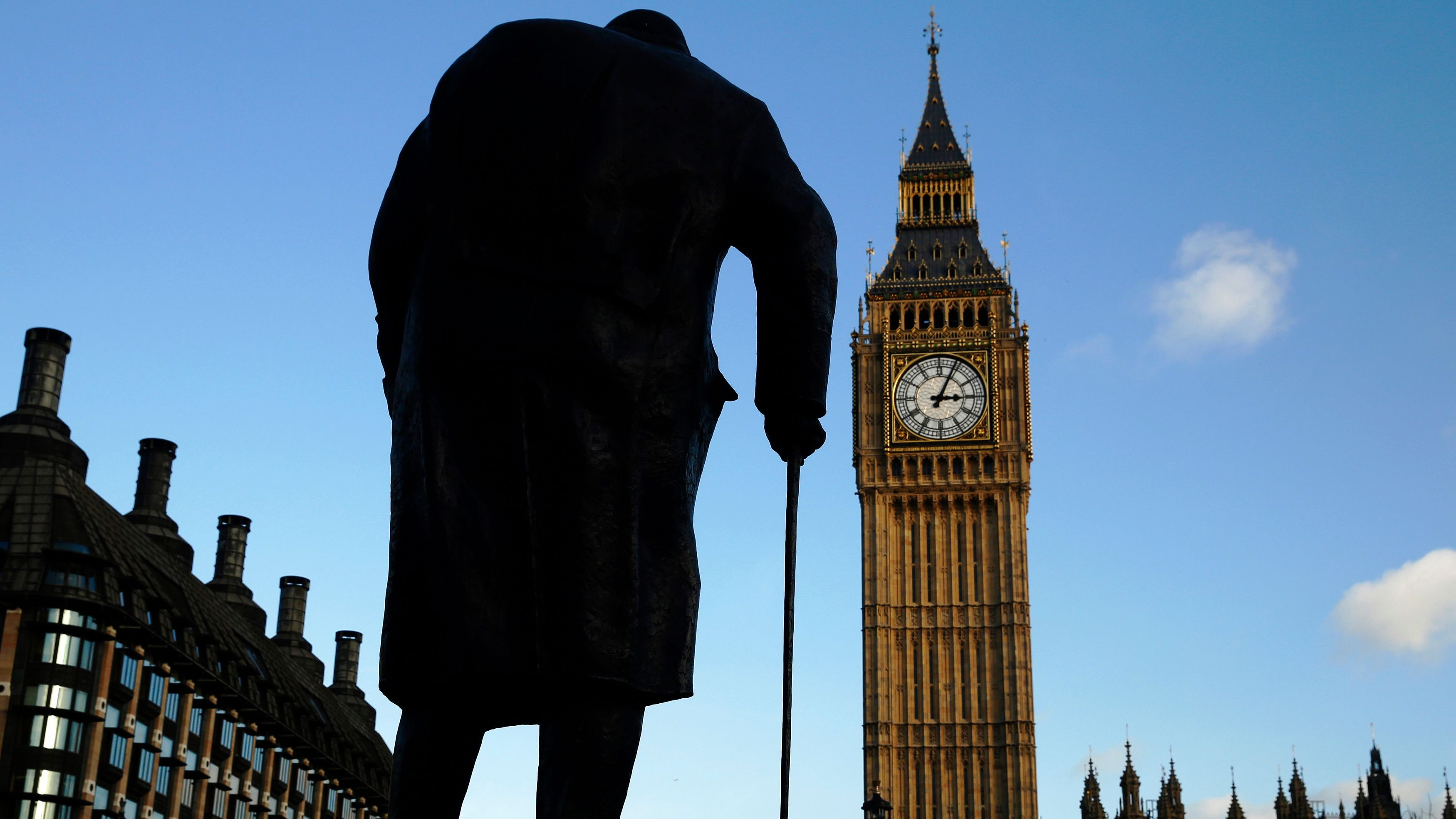 The statue of Britain's former Prime Minister Winston Churchill is silhouetted in front of the Houses of Parliament in London