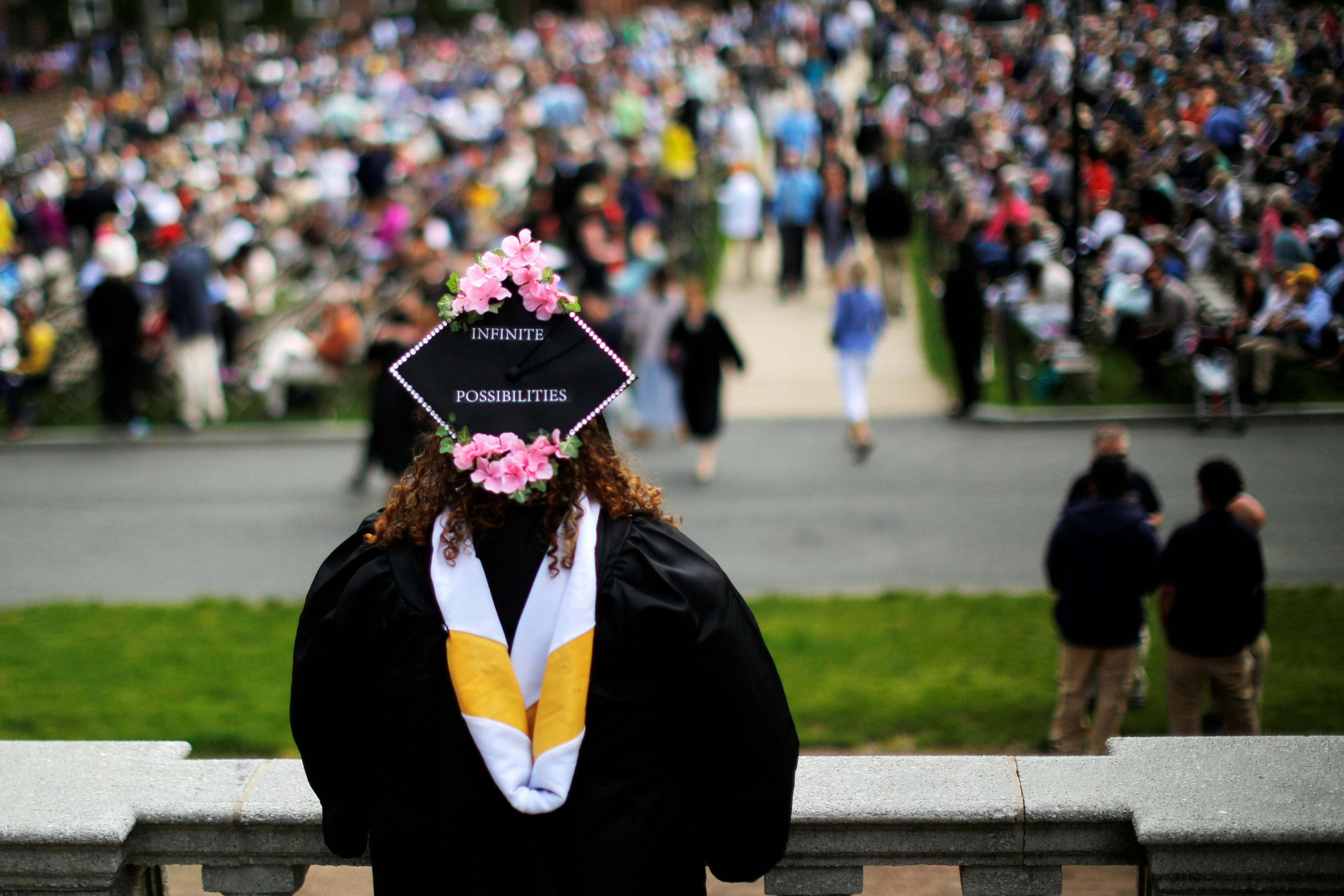 """A senior with """"Infinite Possibilities"""" written on her cap waits to graduate during Commencement at Smith College in Northampton, Massachusetts, U.S., May 21, 2017"""