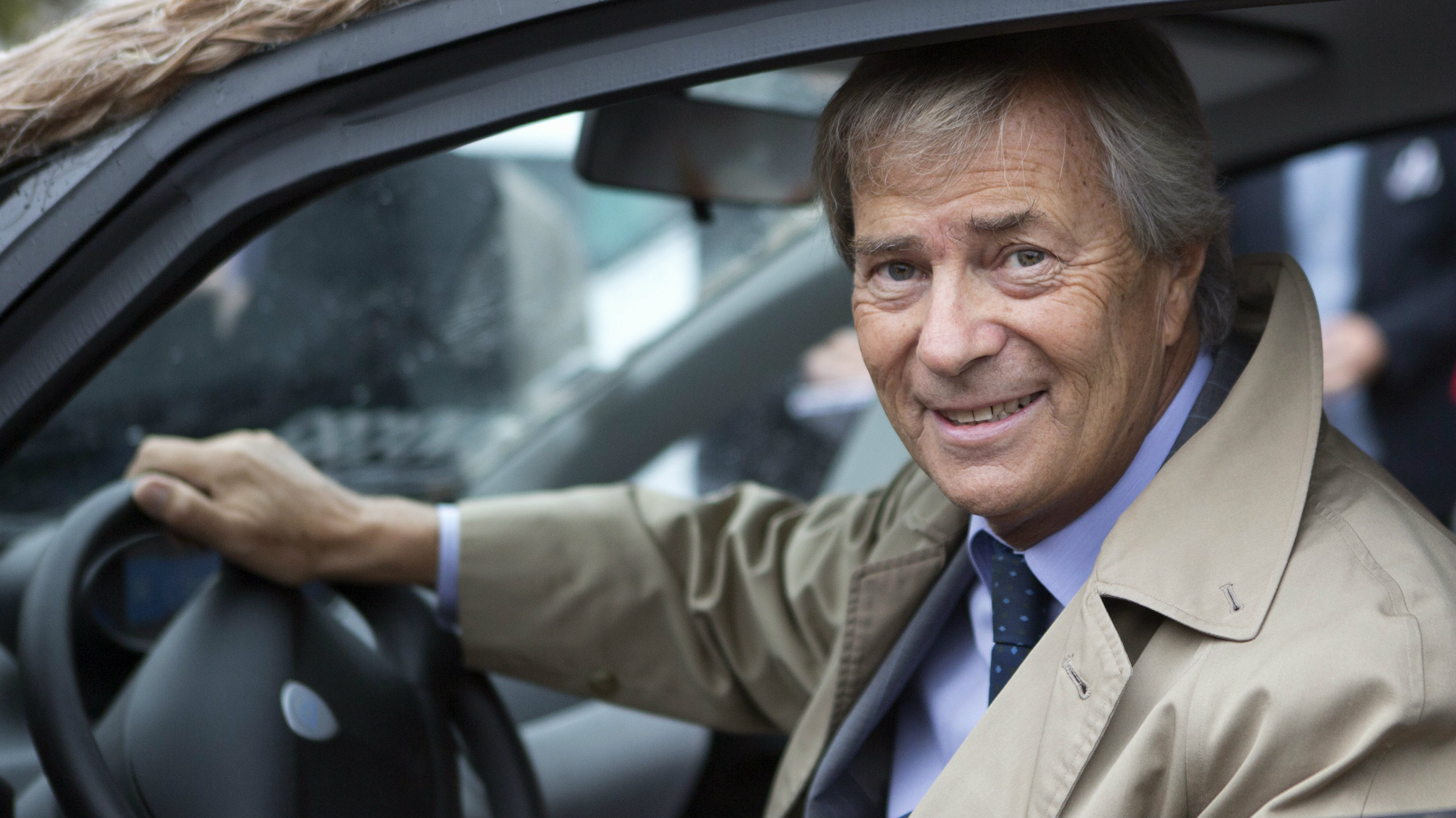 n this Oct.8, 2014 file photo, France's Vincent Bollore, head of the Bollore Group, sits in a customized Autolib electric car in Paris. French billionaire Vincent Bollore has been detained for questioning in an investigation into alleged corruption in lucrative port deals in Africa. French newspaper Le Monde says the investigation focuses on suspicions around port deals in 2010 in Lome, the capital of the West African nation of Togo, and Conakry in Guinea.