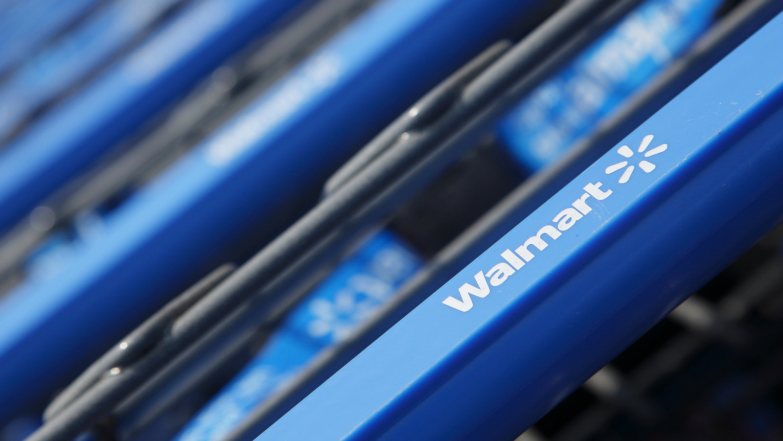 Shopping carts are seen outside a new Walmart Express store in Chicago July 26, 2011. Wal-Mart Stores Inc is opening its first small store in Chicago on Wednesday as it tests a format it hopes will allow it to penetrate urban markets that have resisted its huge stores.