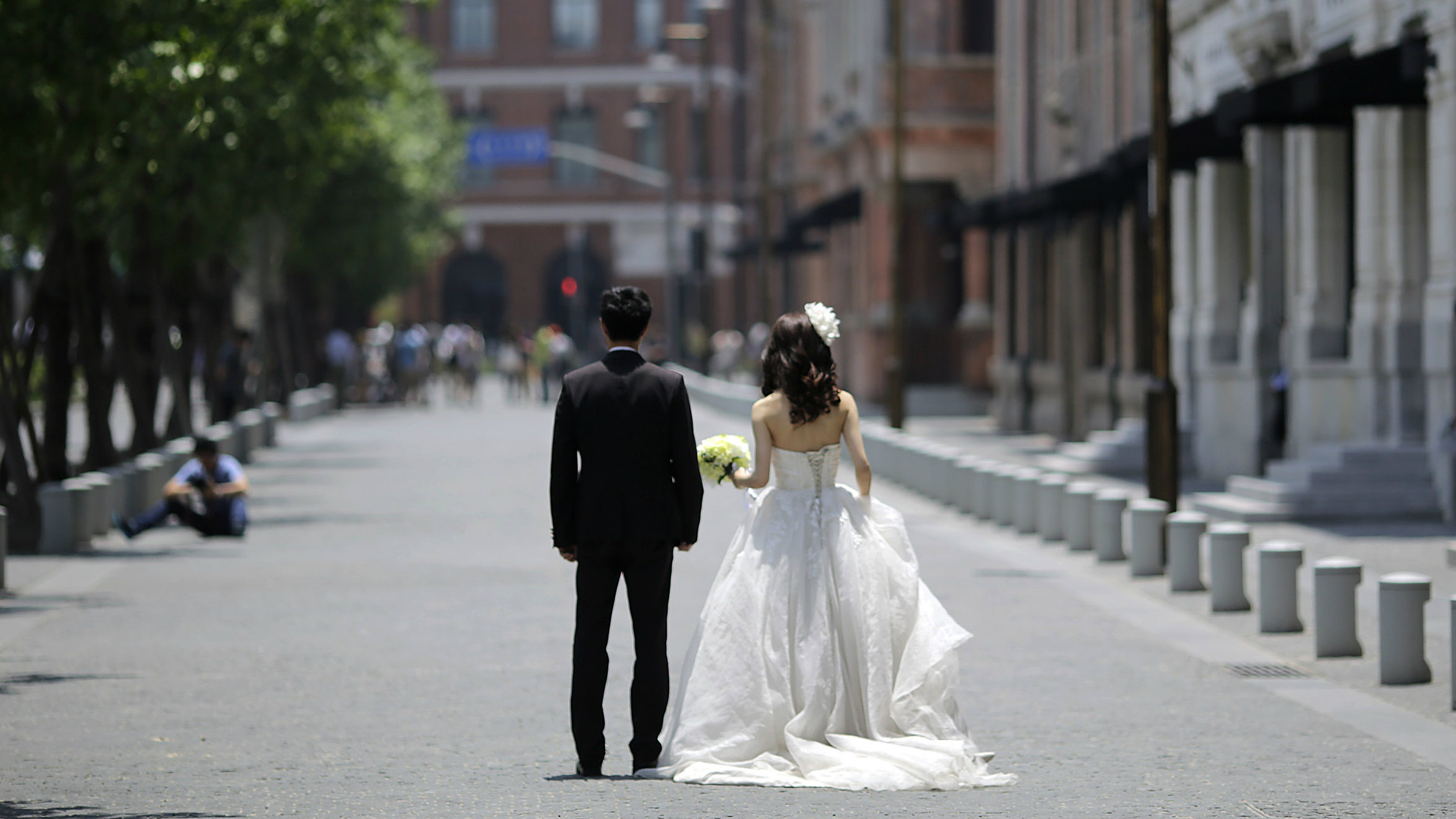 A newlywed couple waits for a wedding photo session