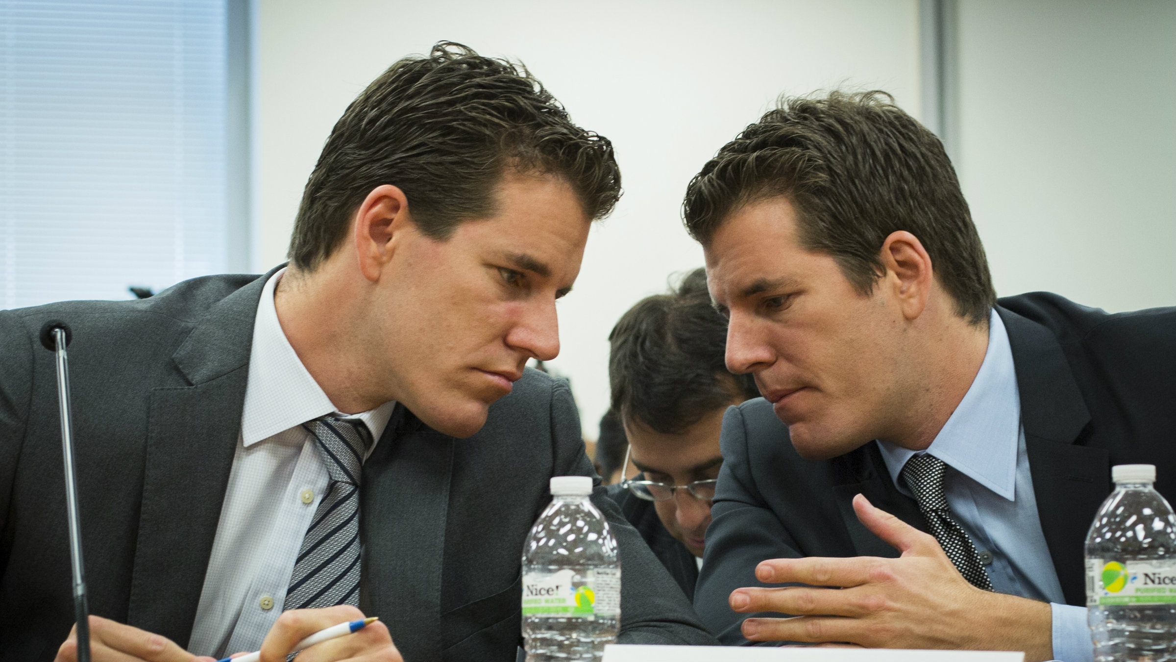Cameron and Tyler Winklevoss talk to each other