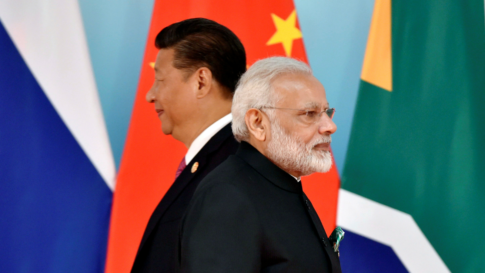Chinese President Xi Jinping (L) and Indian Prime Minister Narendra Modi attend the group photo session during the BRICS Summit at the Xiamen International Conference and Exhibition Center in Xiamen, Fujian Province, China September 4, 2017. REUTERS/Kenzaburo Fukuhara/Pool/File Photo