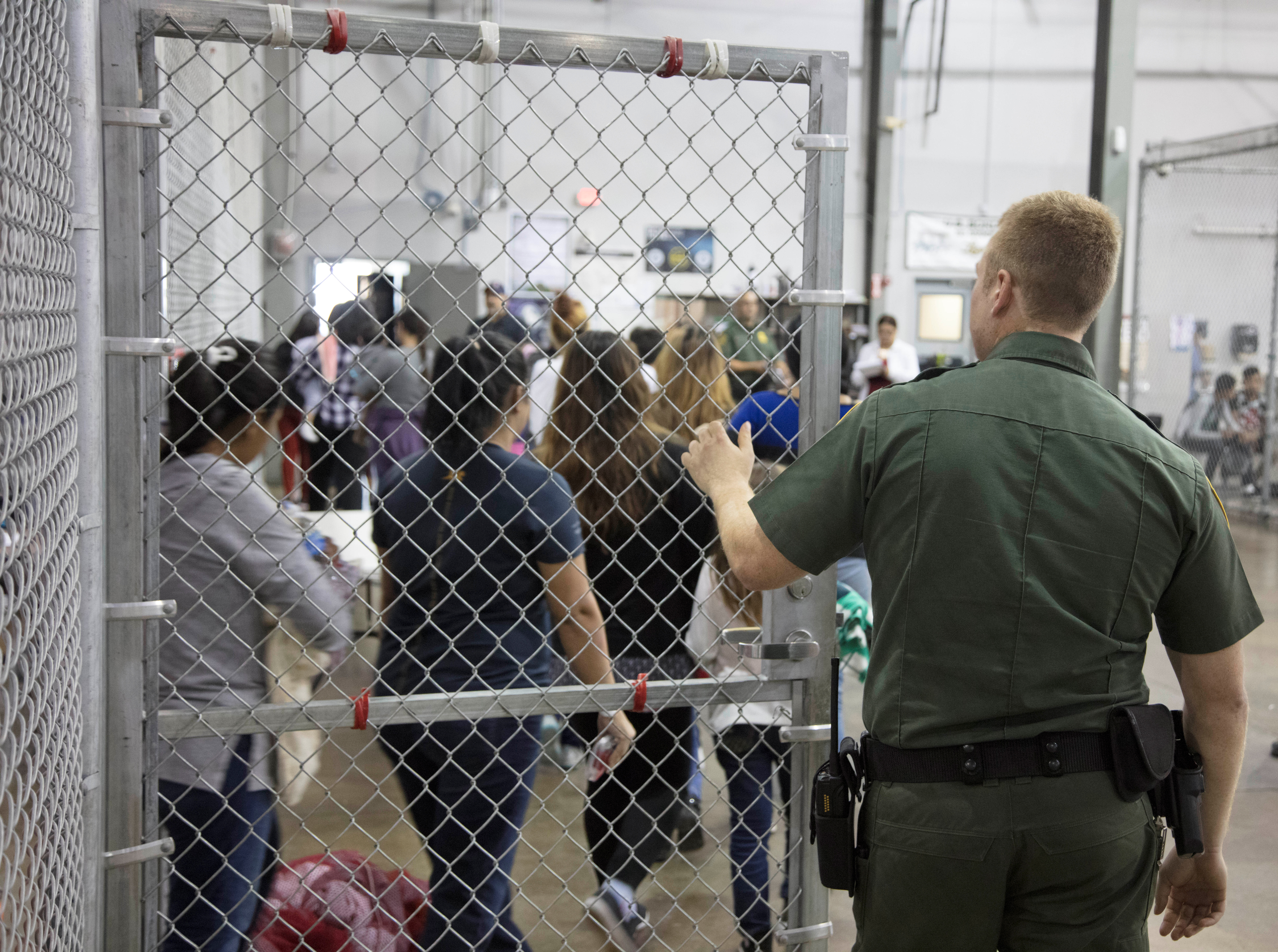 Photo inside U.S. Customs and Border Protection (CBP) detention facility shows detainees inside fenced areas at Rio Grande Valley Centralized Processing Center in Texas. Picture taken on June 17, 2018, provided by US Customs and Border Protection.