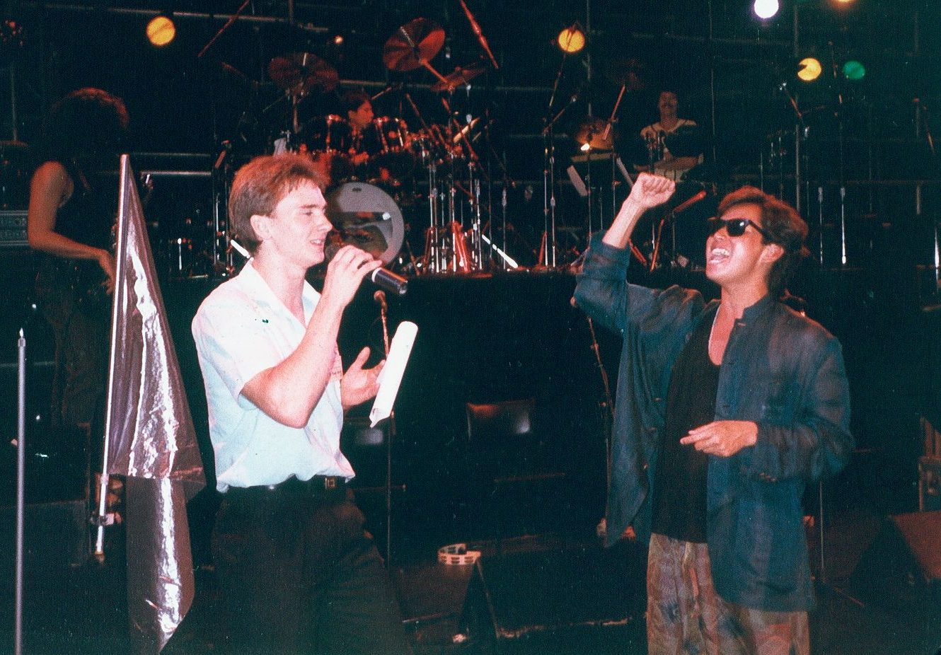Gregory Rivers, left, on stage with Cantopop superstar Alan Tam in 1986 in Sydney, Australia.