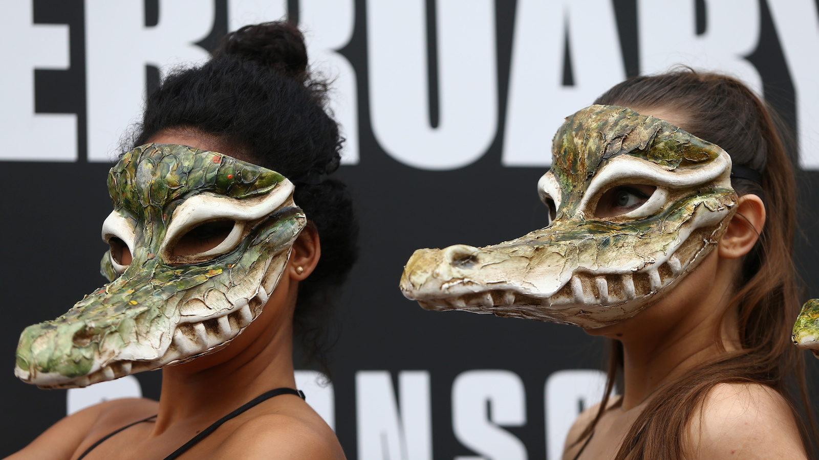 Peta models in crocodile masks protest against the use of crocodile skins in fashion during London Fashion Week in London, Britain February 17, 2017. REUTERS/Neil Hall - RC1F6C286DB0