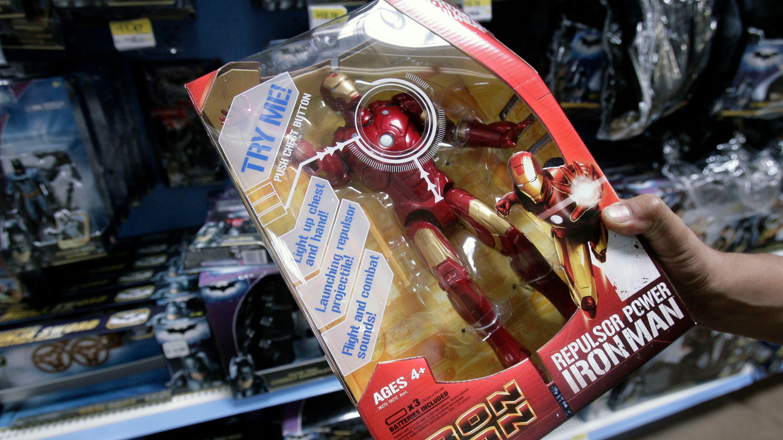 A shopper examines an Iron Man toy at a Walmart Supercenter Thursday, Oct. 2, 2008, in Rosemead, Calif. (AP Photo/Ric Francis)