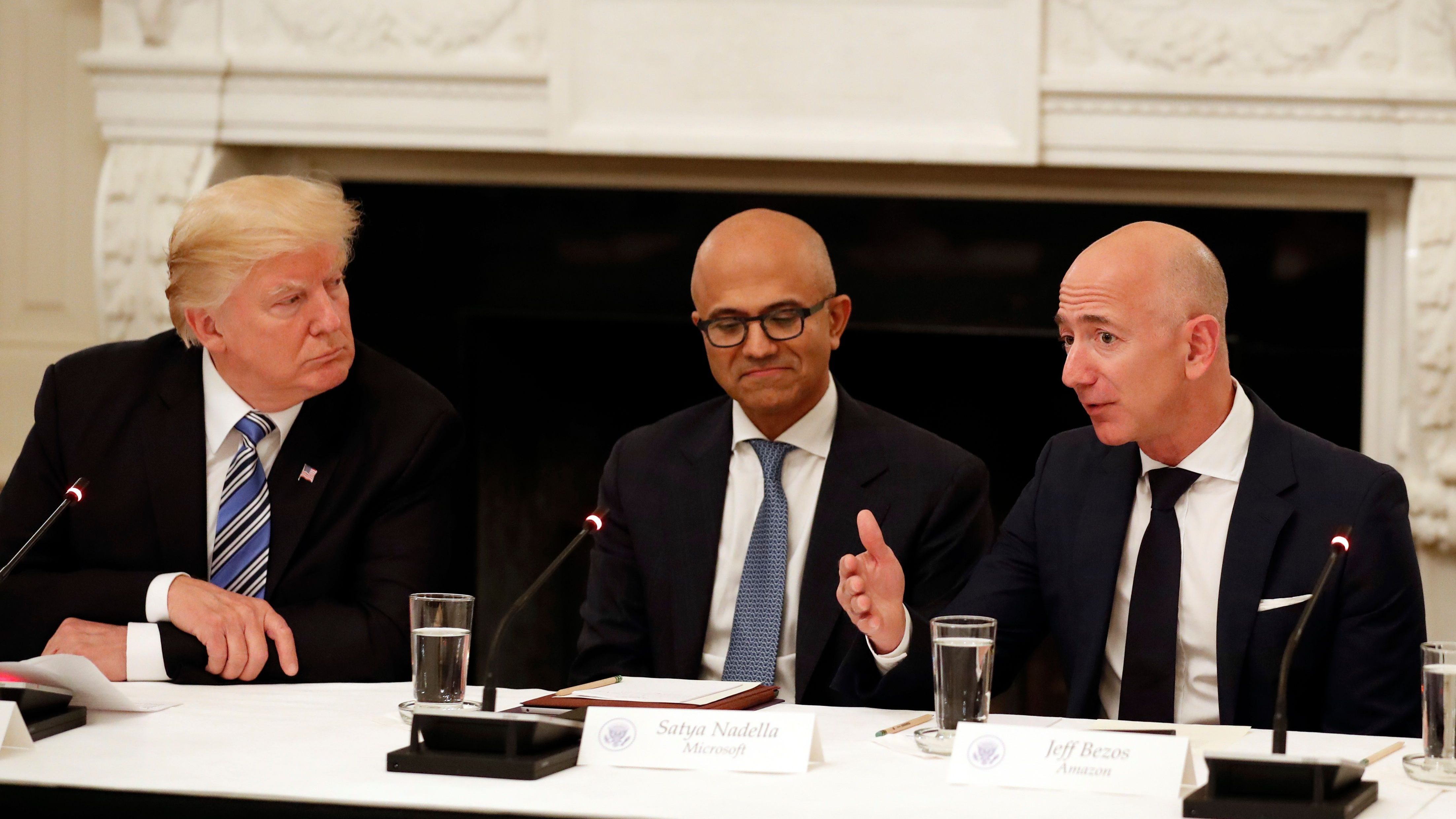 Amazon CEO Jeff Bezos with president Donald Trump.