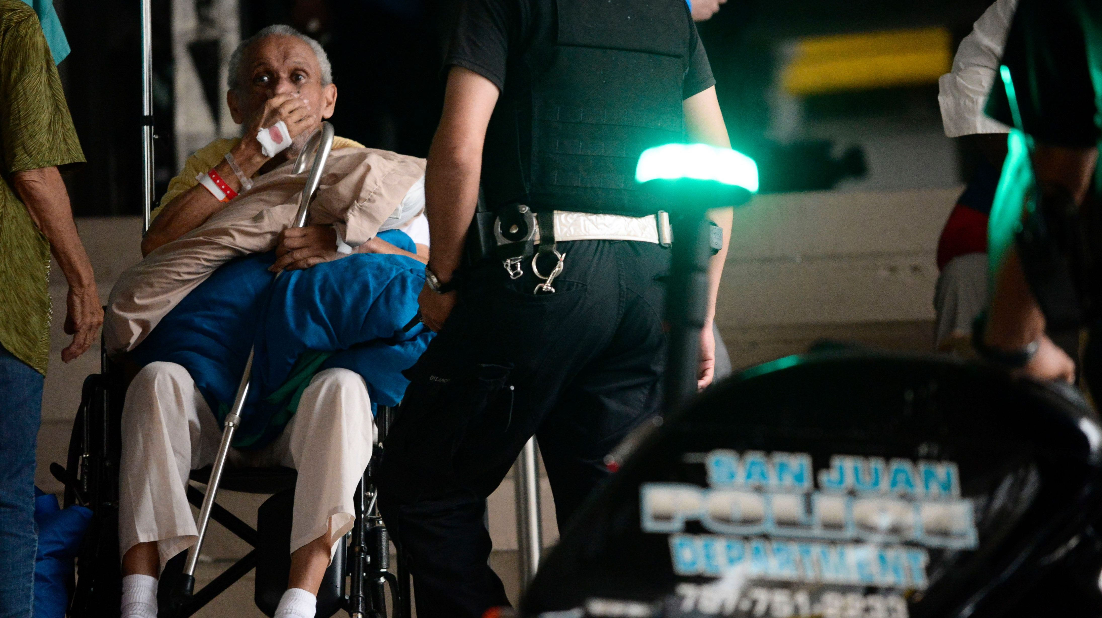 A patient waits to be evacuated from the San Francisco hospital after an electrical plant failure due to hurricane maria