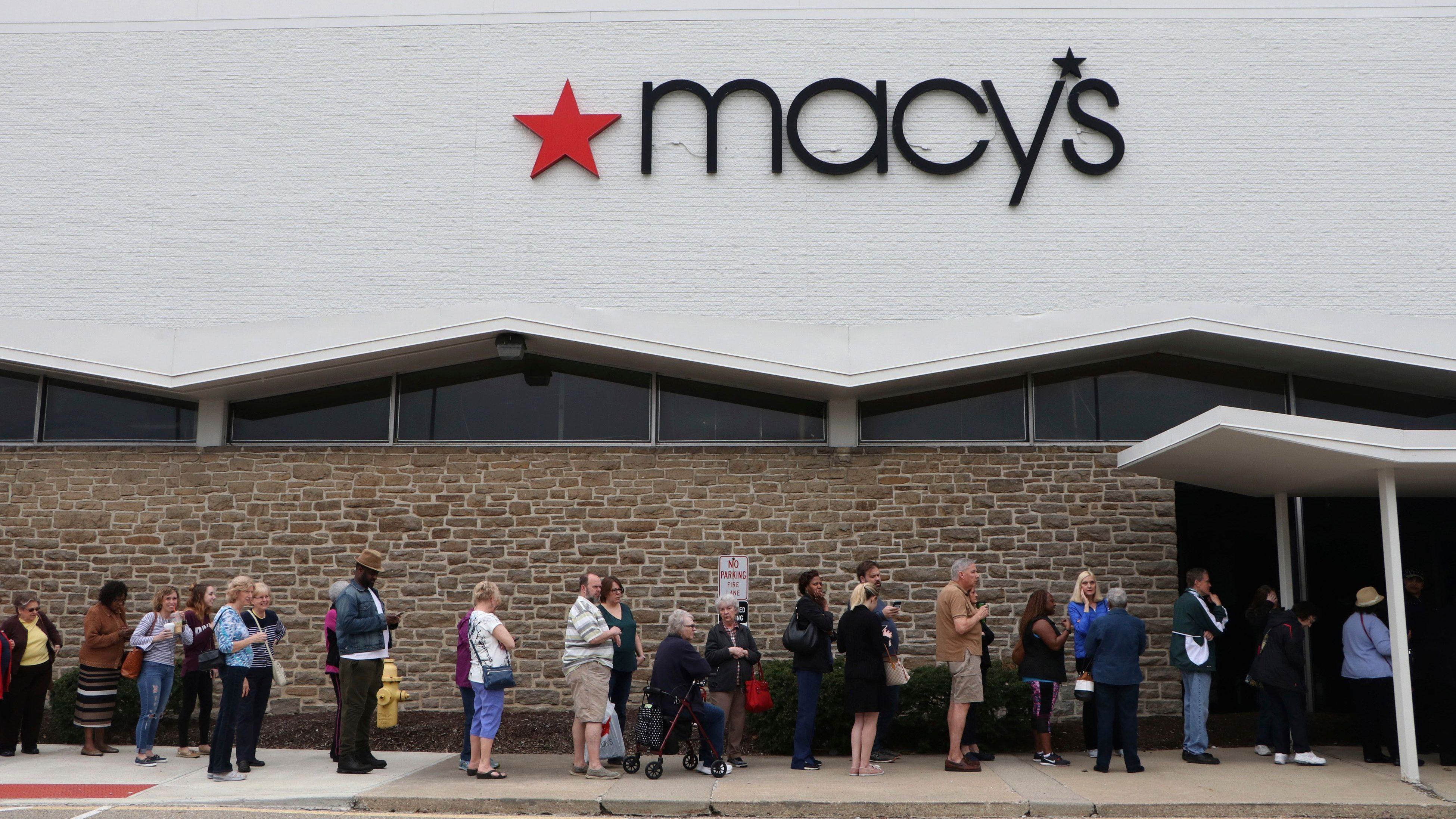 Customers line up to get into the grand opening of Macy's Backstage at Tri-County Mall on Saturday, April 14, 2018 in Cincinnati.