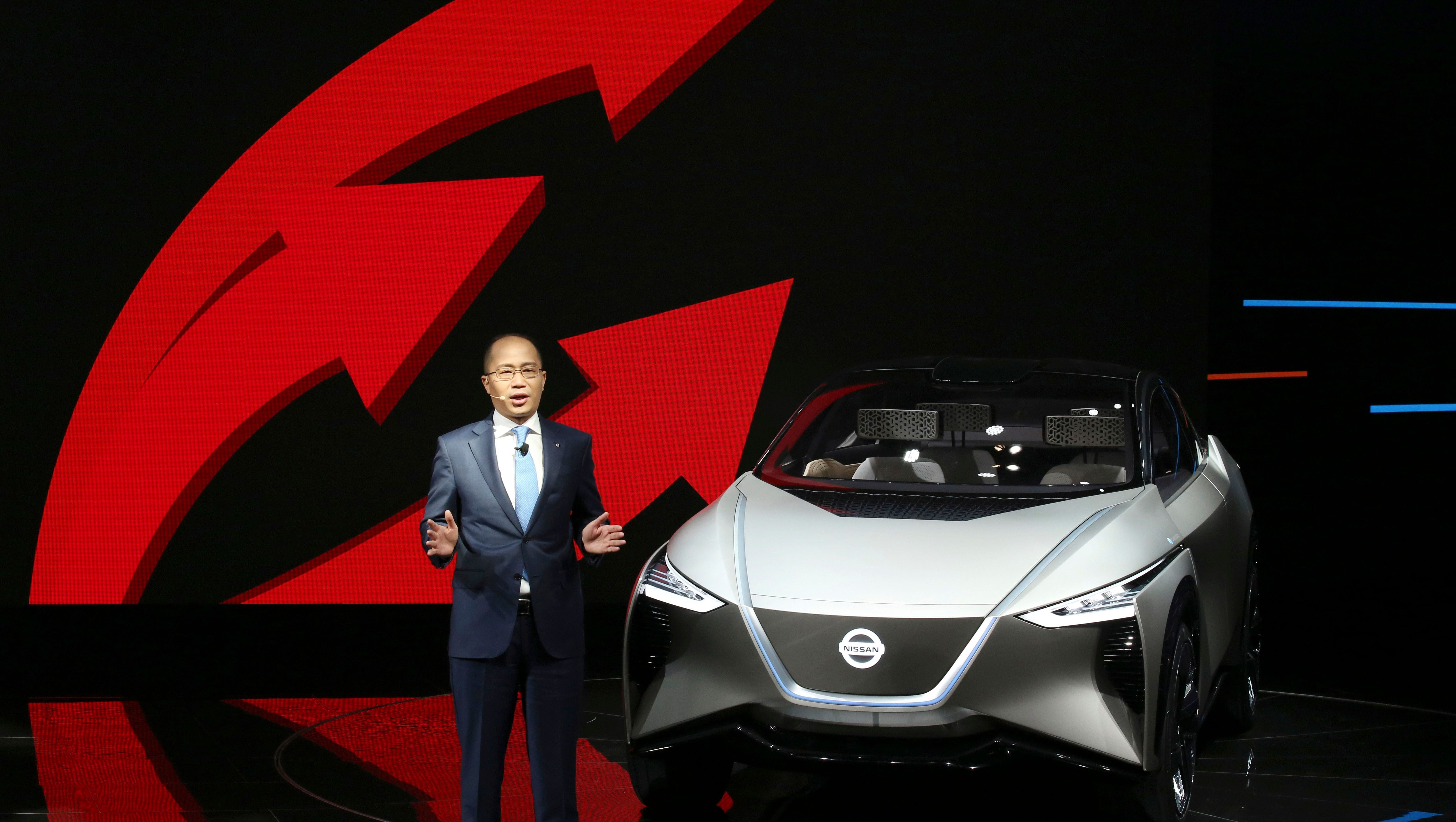 Chen Hao, Dongfeng Nissan Passenger Vehicle company's deputy managing director speaks near the Nissan IMX concept car during the start of the Auto China 2018 in Beijing, China, Wednesday, April 25, 2018. Volkswagen and Nissan have unveiled electric cars designed for China at the Beijing auto show that highlights the growing importance of Chinese buyers for a technology seen as a key part of the global industry's future. (AP Photo/Ng Han Guan)