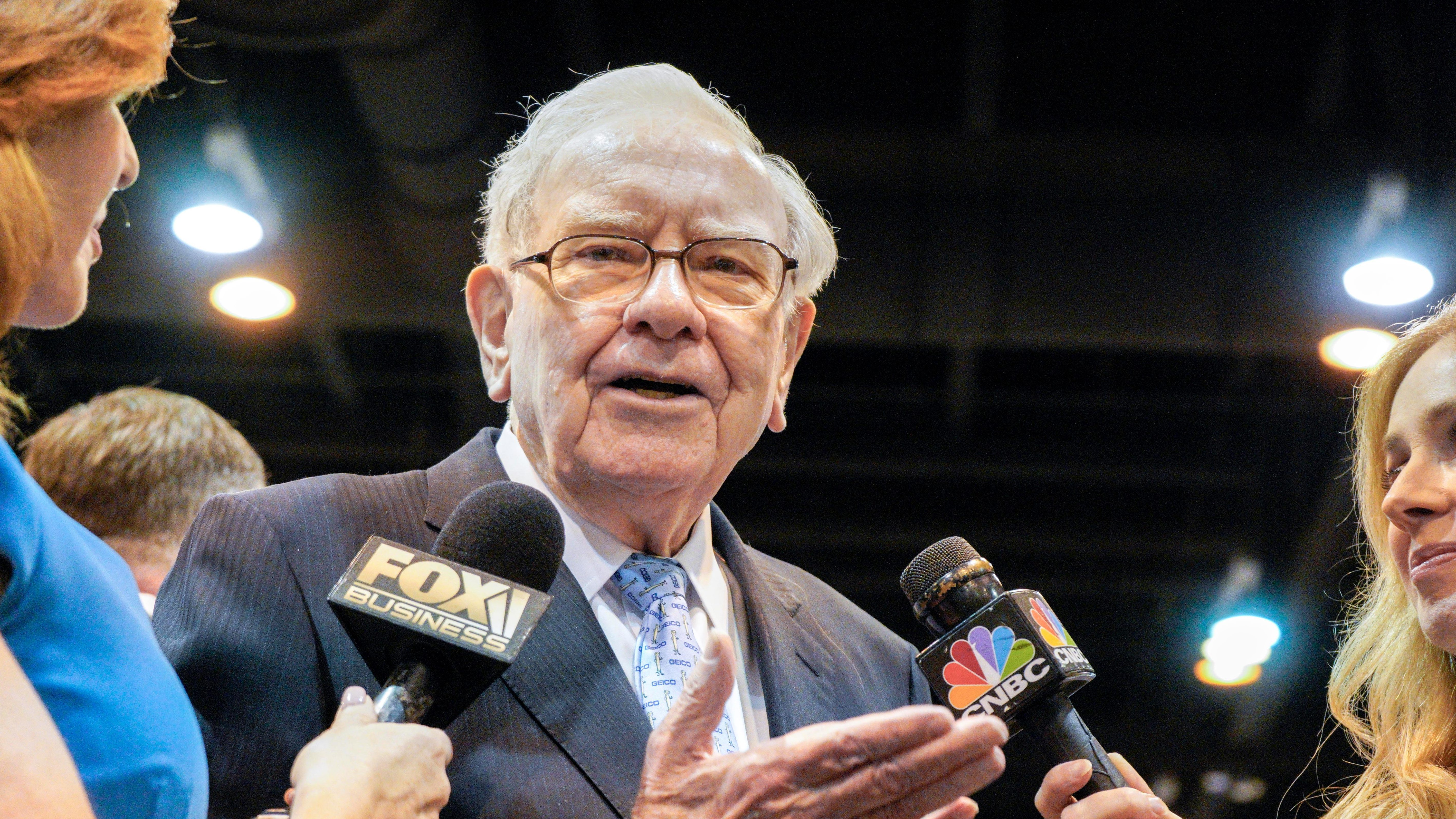 Warren Buffett, Chairman and CEO of Berkshire Hathaway, speaks to reporters during a tour of the exhibit floor at the CenturyLink Center in Omaha, Neb., Saturday, May 5, 2018