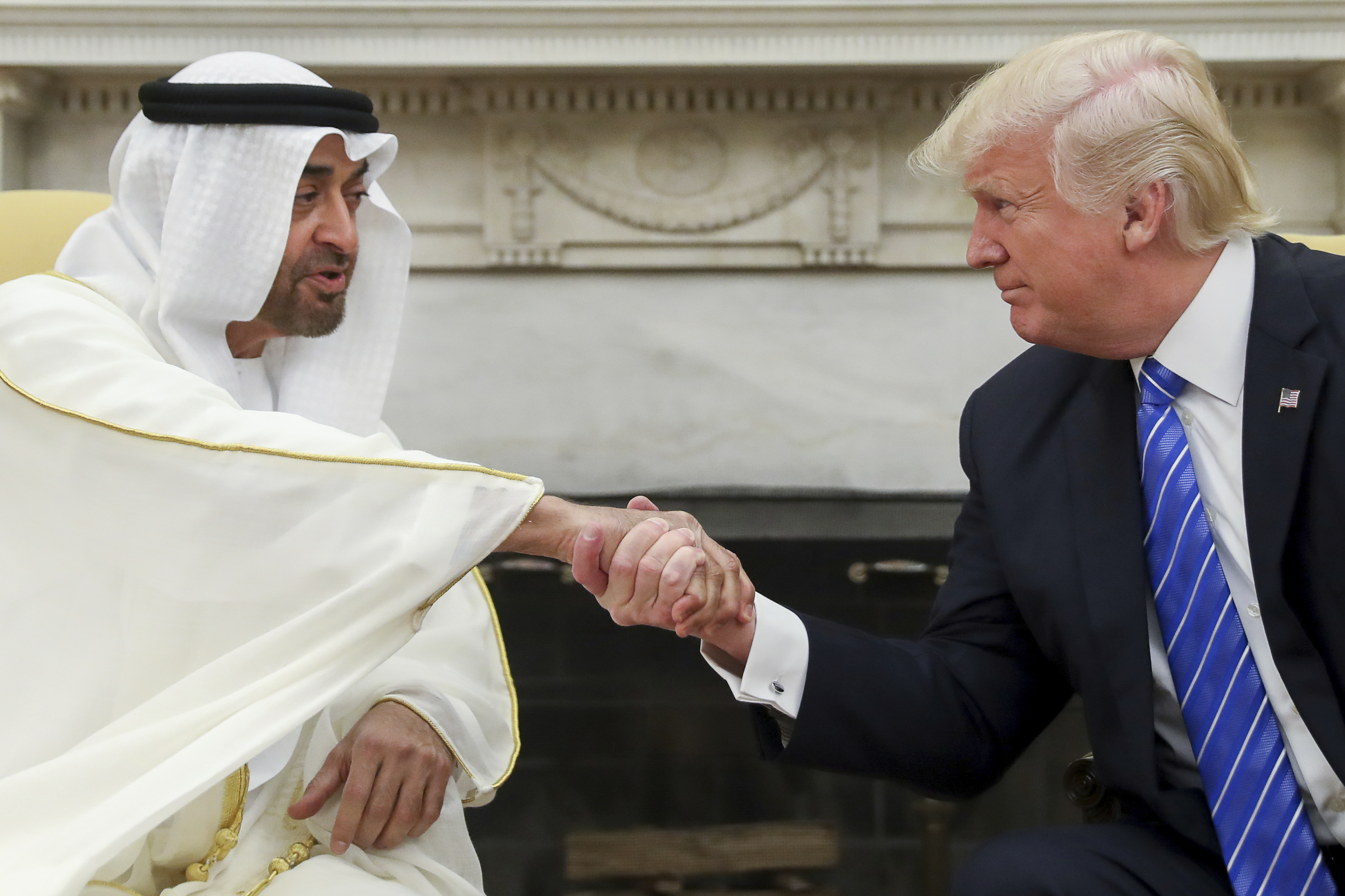 FILE - In this May 15, 2017, file photo, President Donald Trump shakes hands with Abu Dhabi's crown prince, Sheikh Mohammed bin Zayed Al Nahyan, in the White House in Washington. Emails obtained by The Associated Press between business partners Elliott Broidy and George Nader reveal that the pair was working with bin Zayed in a lobbying effort to alter U.S. policy in the Middle East. (AP Photo/Andrew Harnik, File)