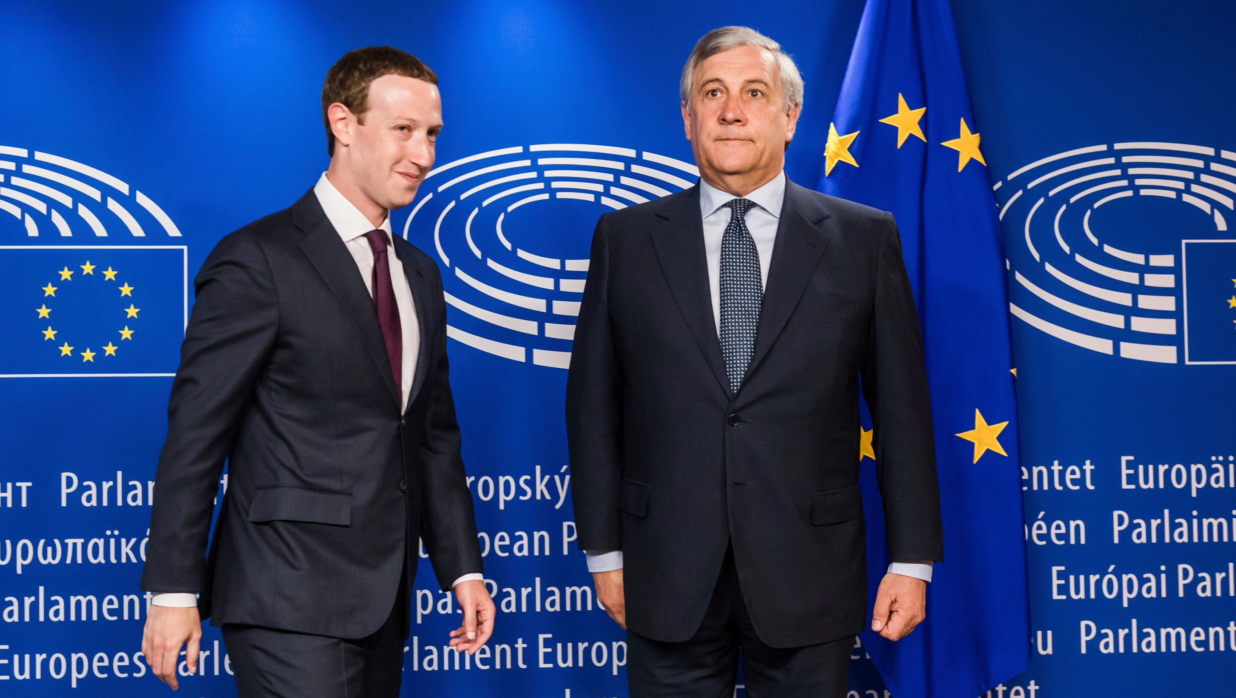 European Parliament President Antonio Tajani, right, welcomes Facebook CEO Mark Zuckerberg upon his arrival at the EU Parliament in Brussels on Tuesday, May 22, 2018. Facebook CEO Mark Zuckerberg faces senior European Union lawmakers today to answer questions about a scandal over the alleged misuse of the data of millions of Facebook users. (AP Photo/Geert Vanden Wijngaert)