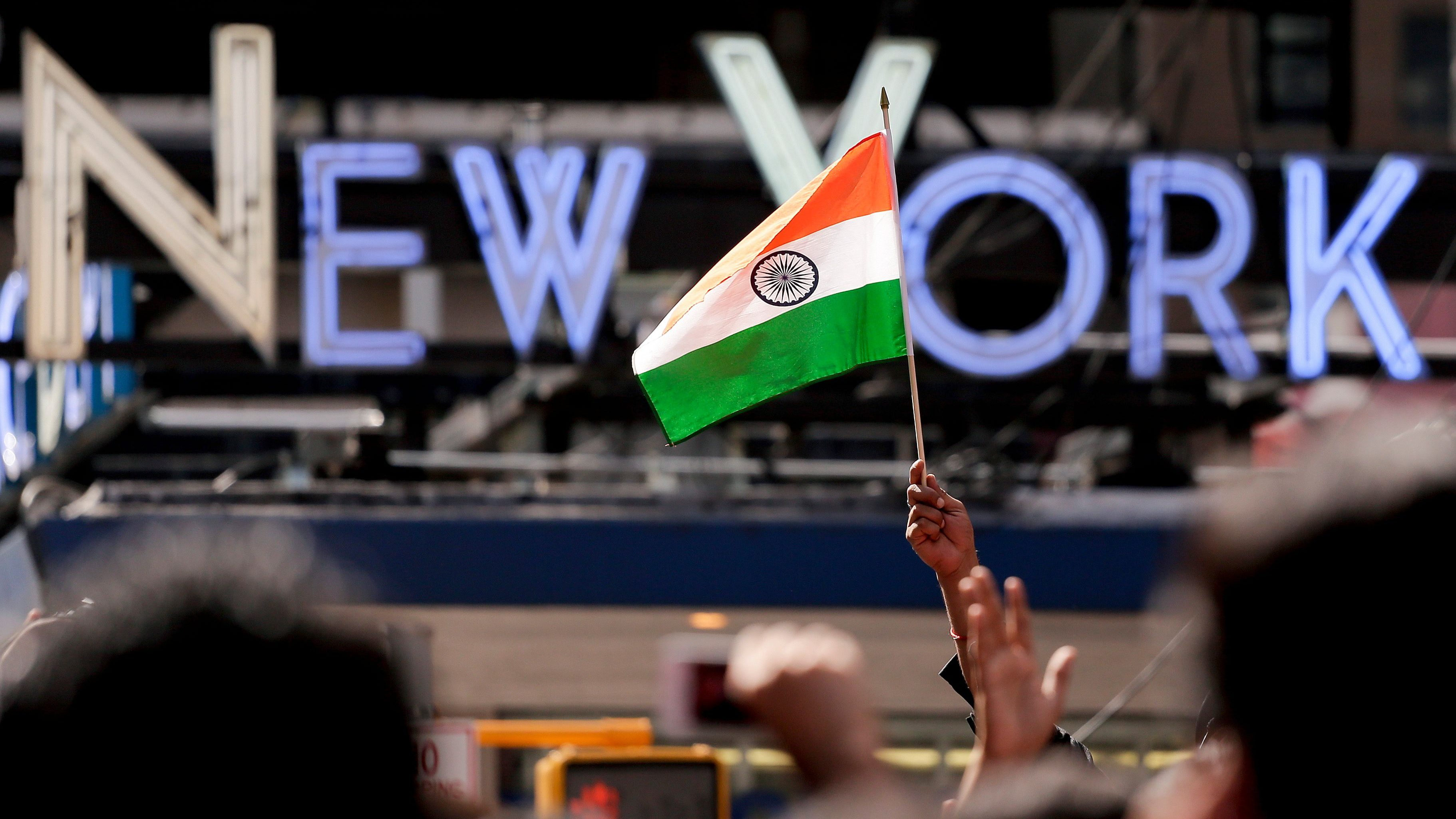Members of the Indian-American community gather in Times Square to watch a live stream of Indian Prime Minister Narendra Modi who spoke to a capacity crowd at Madison Square Garden, Sunday, Sept. 28, 2014, in New York. A day after addressing a hushed U.N. General Assembly, where headphone-wearing delegates rarely break into a smile, India's new prime minister told a packed and boisterous crowd to help him develop his nation's economy, vowing that under his leadership, India won't look back. (AP Photo/Julie Jacobson)