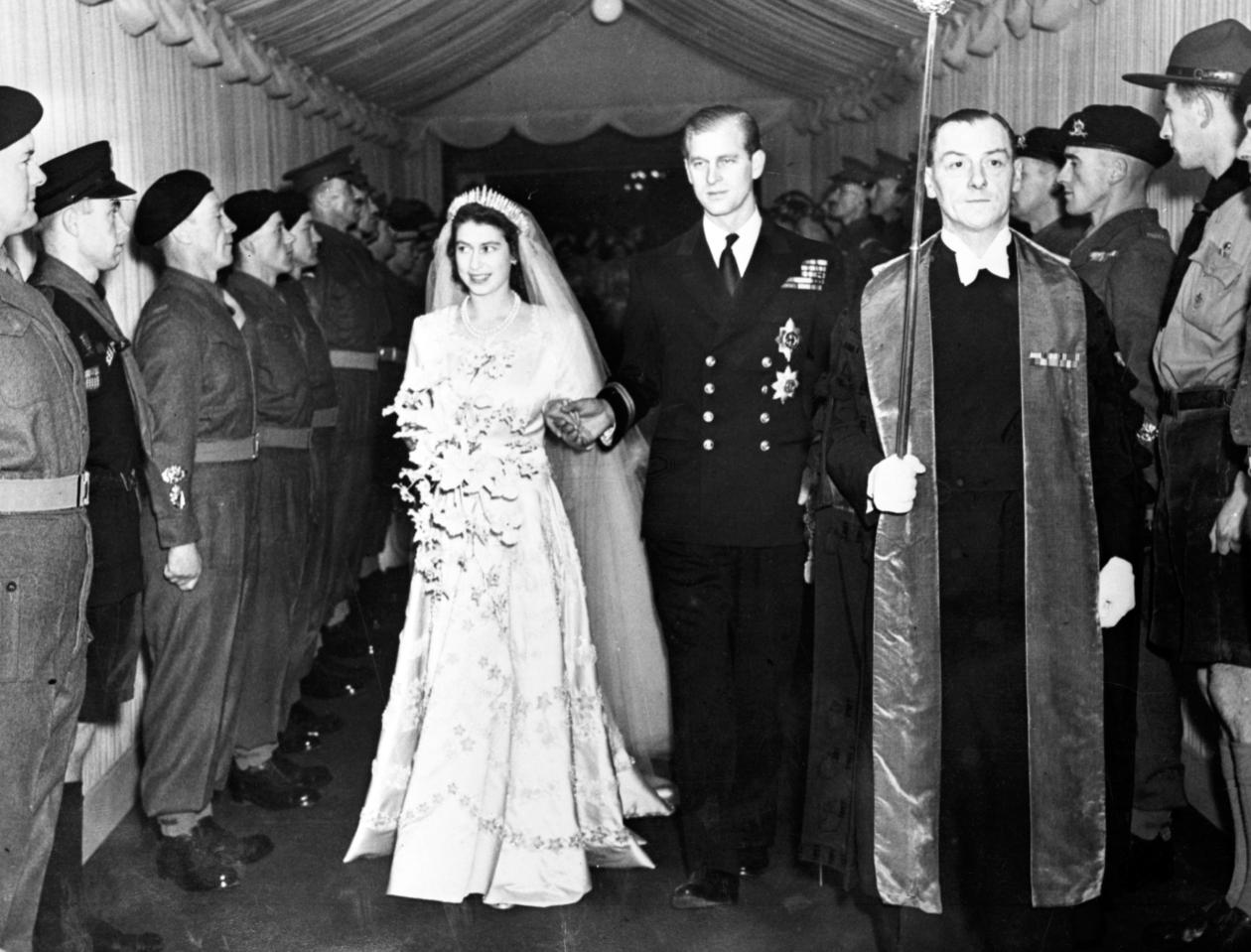 Britain's Princess Elizabeth and her husband the Duke of Edinburgh are seen leaving Westminster Abbey, London, on Nov. 20, 1947, following their wedding service. (AP Photo)