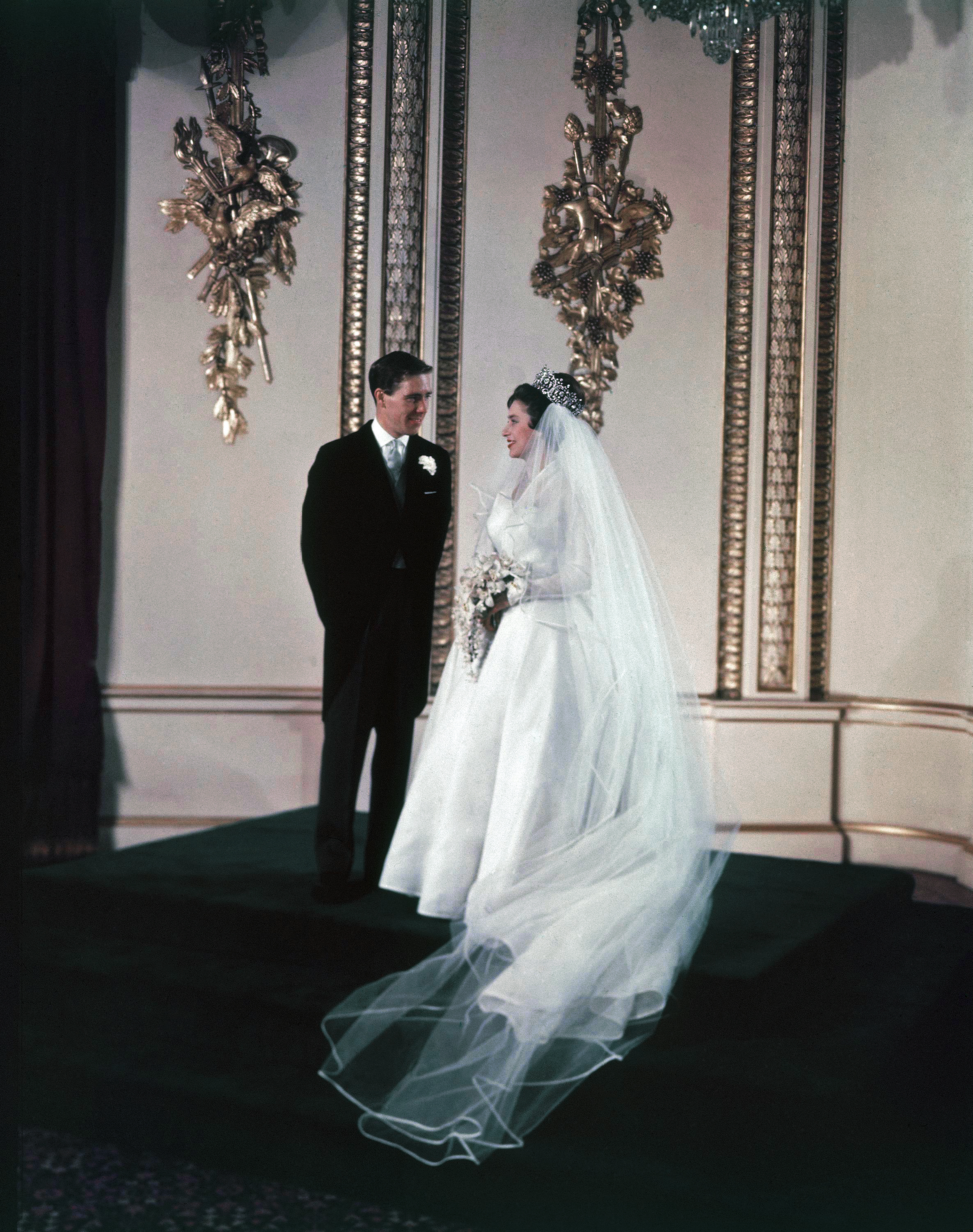 Great Britain Princess Margaret with Anthony Armstrong Jones at Buckingham Palace after their wedding in Westminster Abbey on May 6, 1960. (AP Photo)