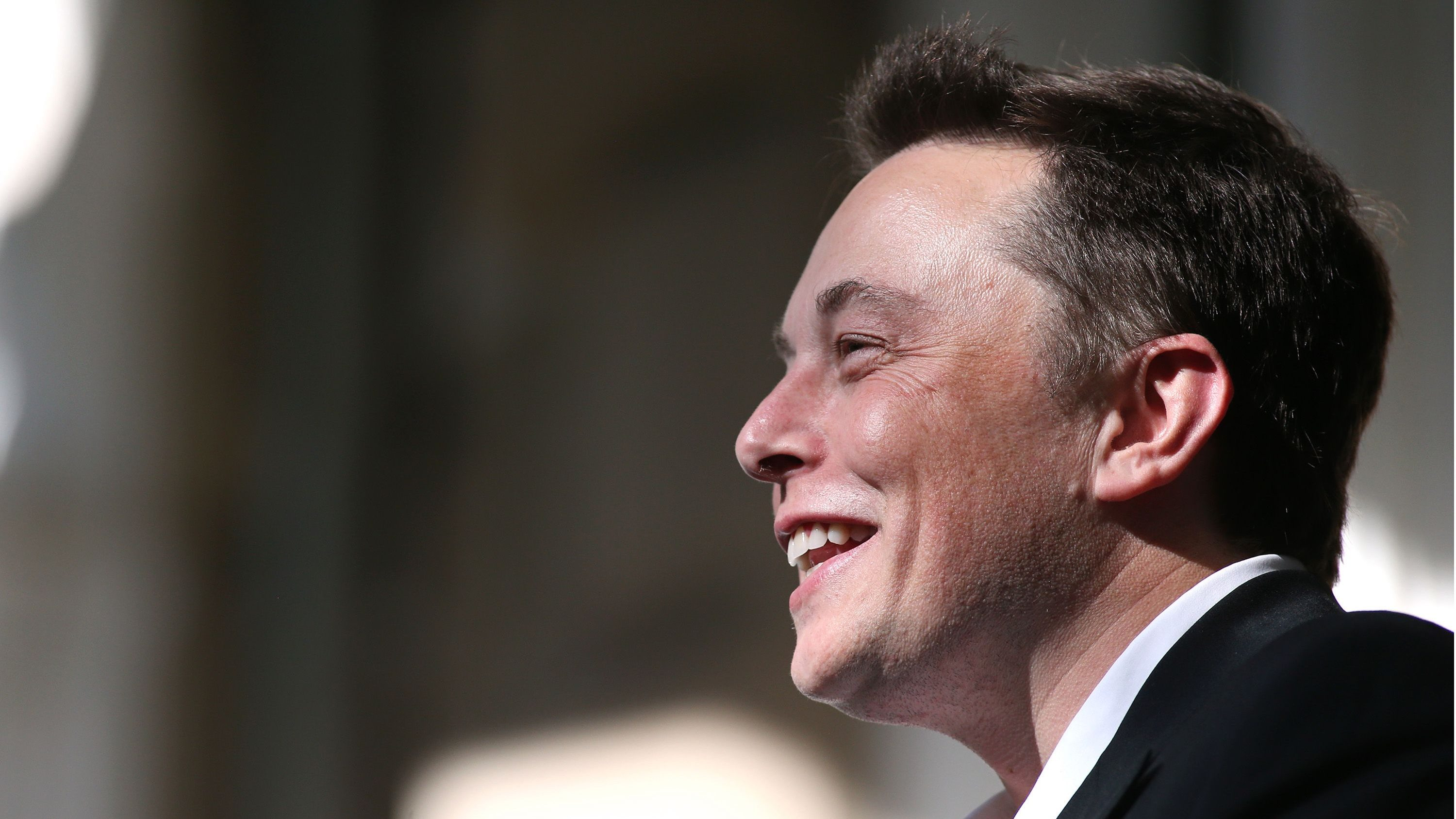 Tesla Motors CEO Elon Musk speaks at a press conference after Nevada was chosen as the new site for a $5 billion car battery gigafactory, which will be built east of Reno. Several hundred people attended the media event at the Capitol in Carson City, Nev., on Thursday, Sept. 4, 2014. (AP Photo/Cathleen Allison)