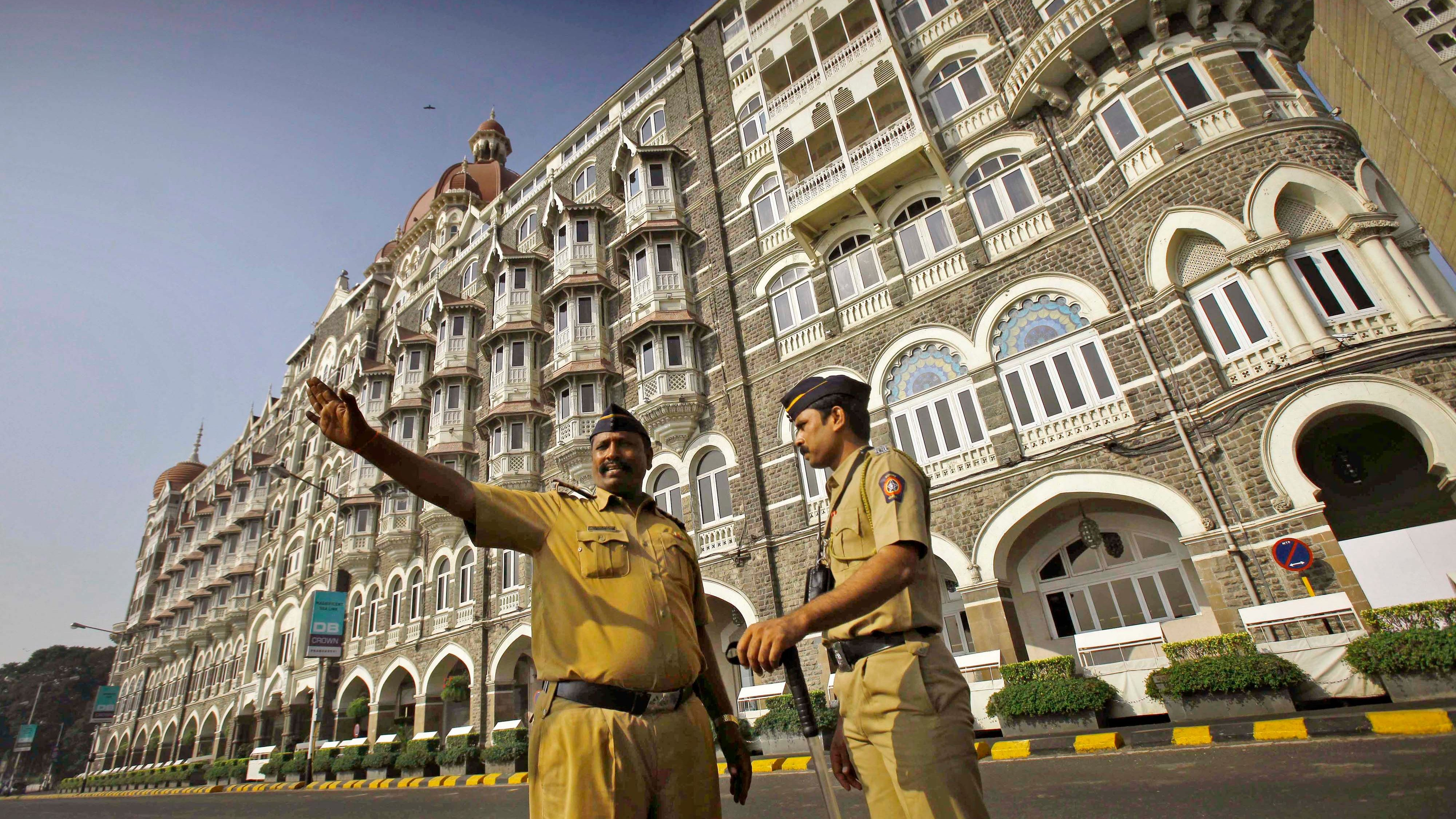 Indian police officers stand outside the Taj Mahal Hotel, one of the sites of the terror attack in Mumbai, India, on its fourth anniversary Monday, Nov. 26, 2012. India secretly executed the lone surviving gunman Mohammed Ajmal Kasab on Nov. 21, from the 2008 Mumbai terror attack, four years after Pakistani gunmen blazed through India's financial capital, killing 166 people and shattering relations between the nuclear-armed neighbors. (AP Photo/Rafiq Maqbool)