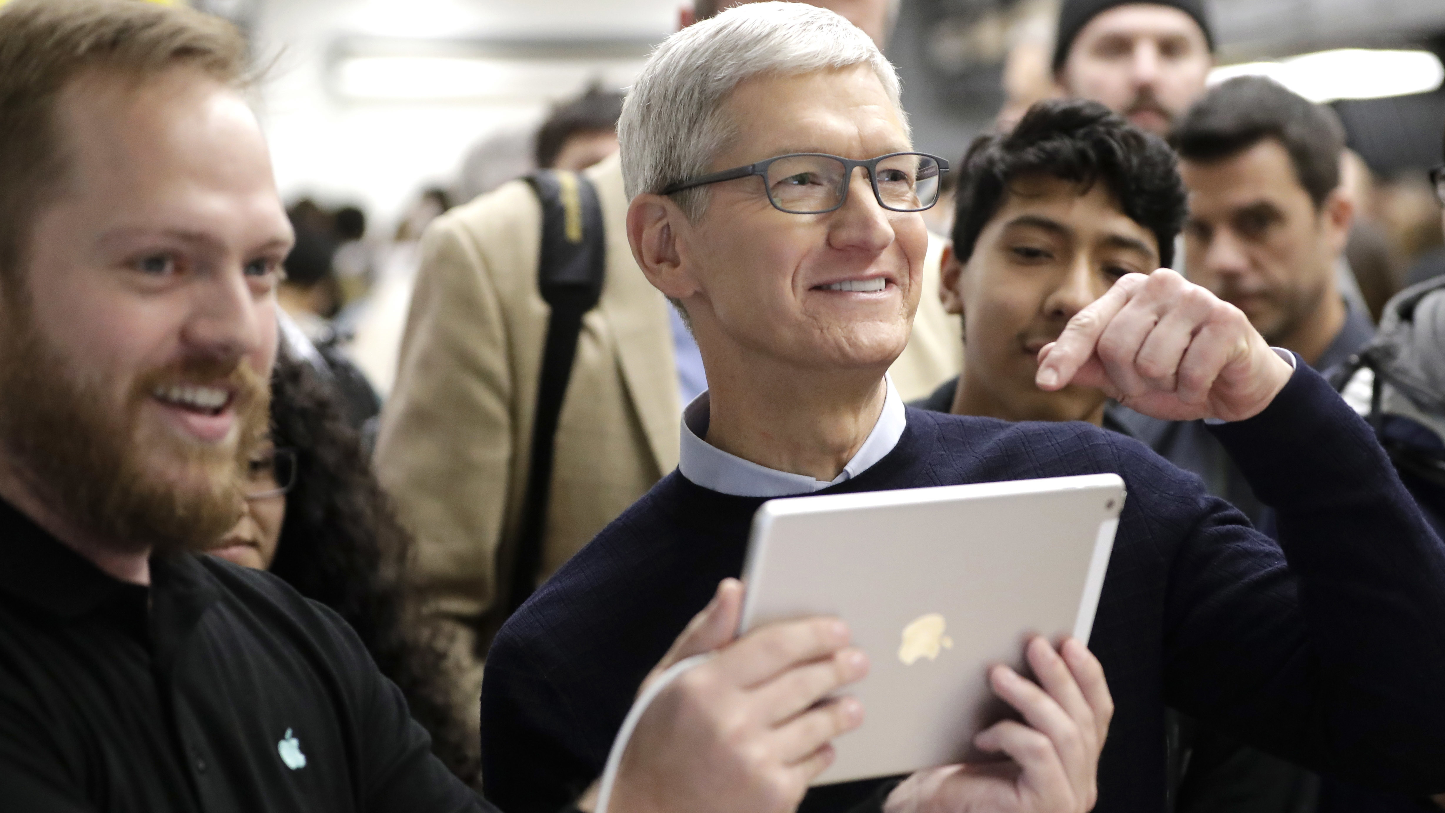 Apple CEO Tim Cook tells reporters they should see what is on the new iPad 9.7-inch screen at an Apple educational event at Lane Technical College Prep High School Tuesday, March 27, 2018, in Chicago. (AP Photo/Charles Rex Arbogast)