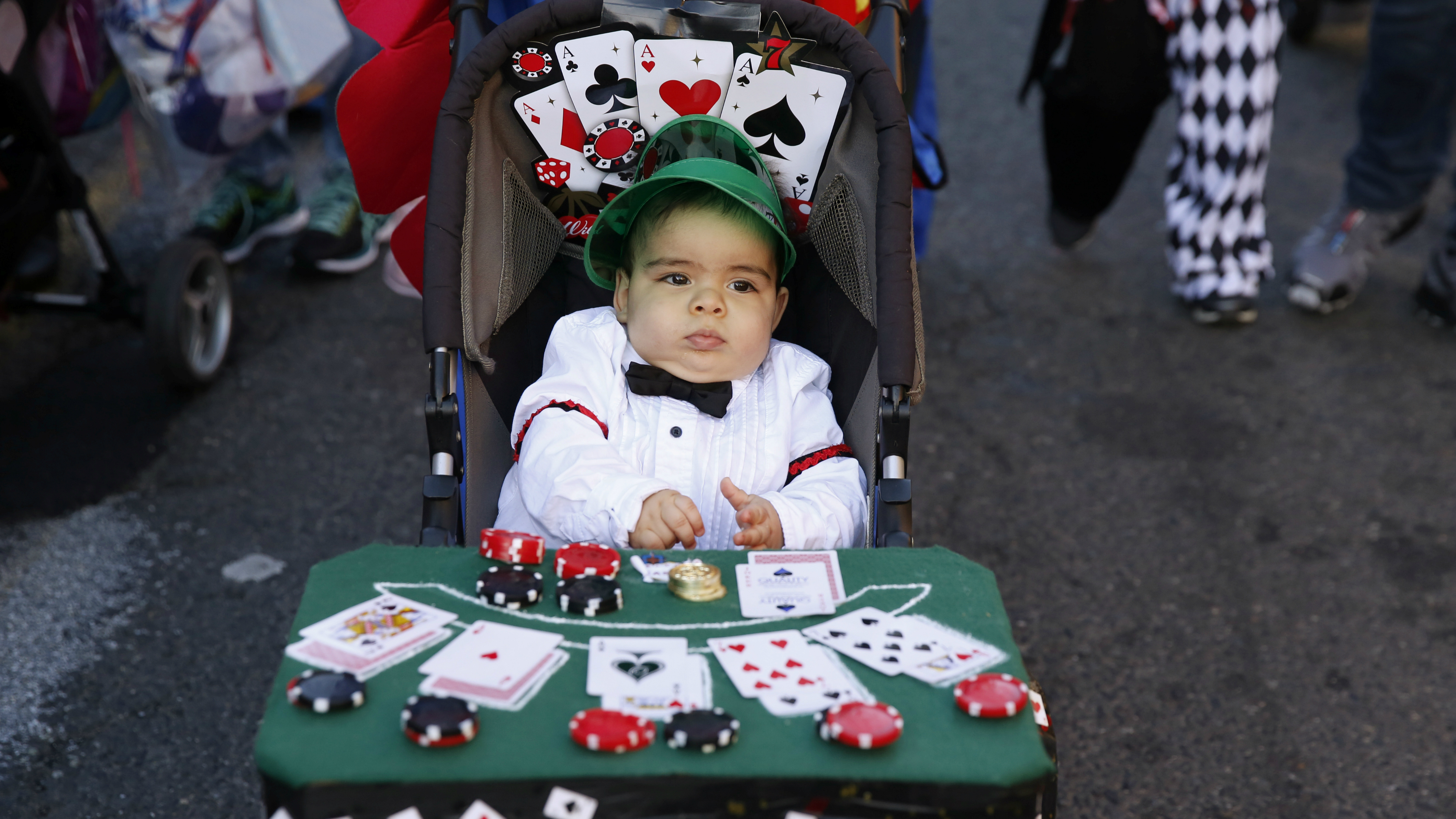 A child dressed up as a card dealer.
