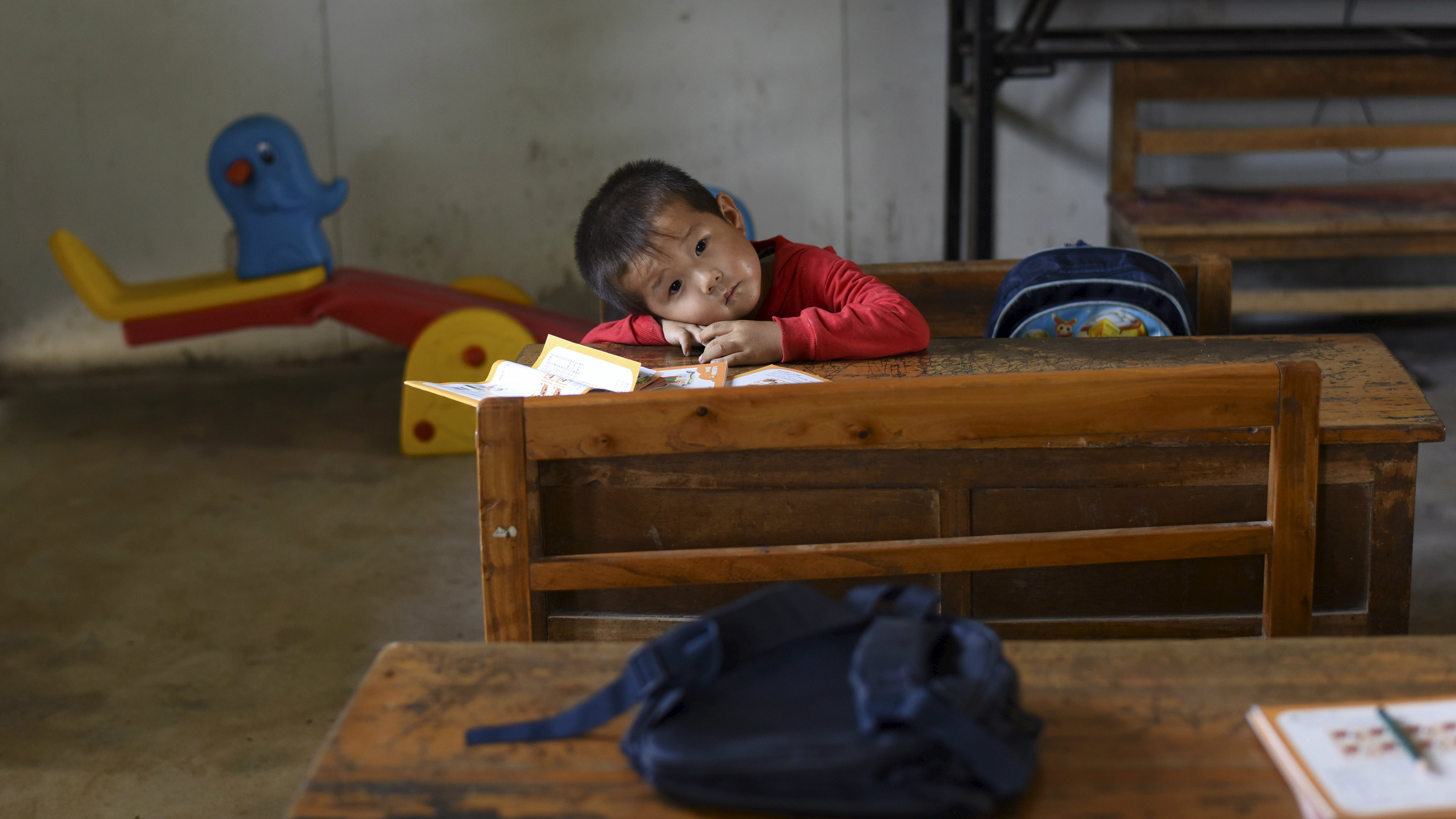 Brookings created a blueprint to help countries around the world a student rests his head on a table inside a classroom of dalu primary school in malvernweather Images
