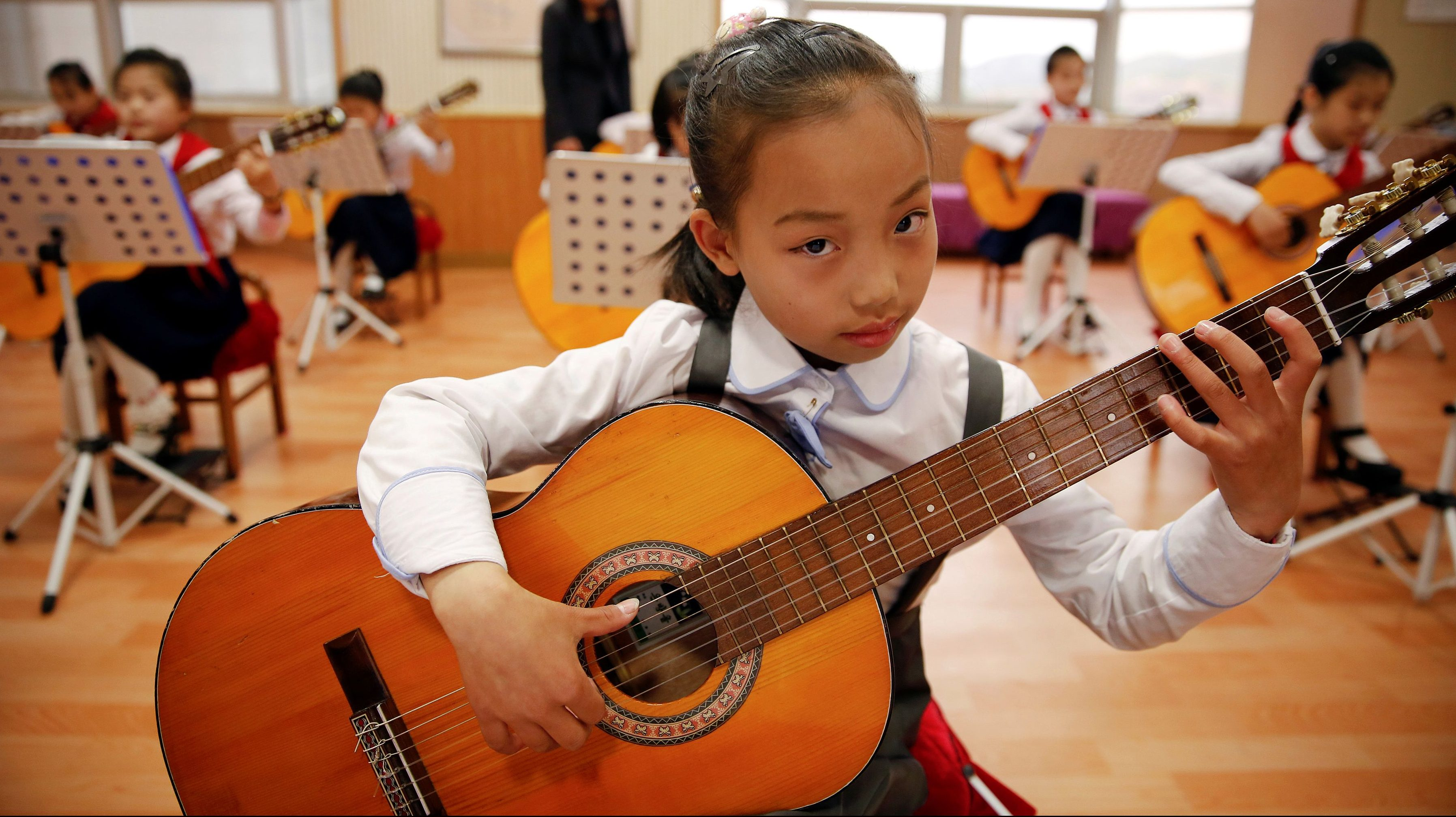 Girls play guitars at the Mangyongdae Children's Palace in central Pyongyang, North Korea, on May 5, 2016.