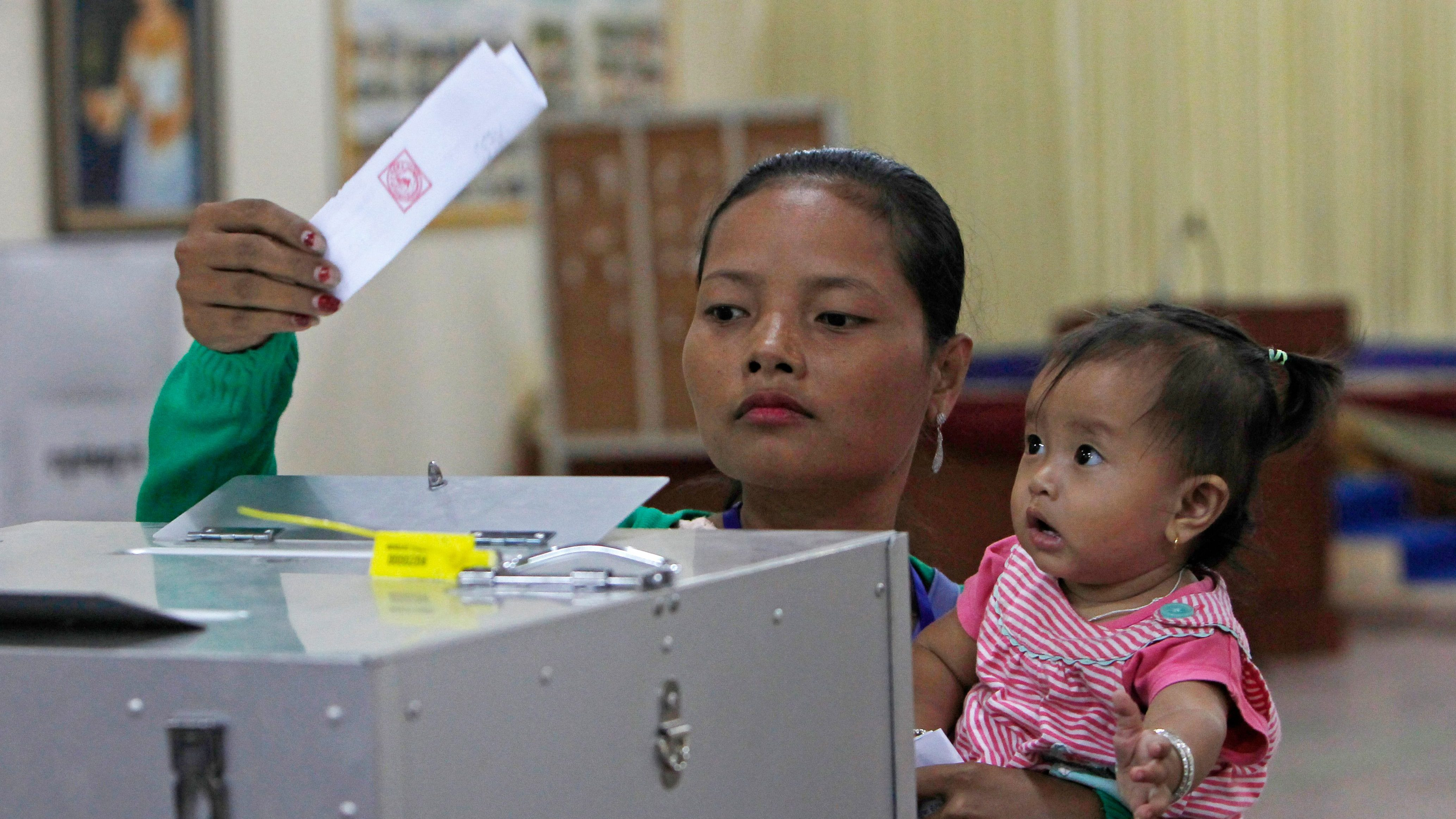 Cambodian woman votes a ballot for the senate election at Takhmau polling station in Kandal province, southeast of Phnom Penh, Cambodia, Sunday, Feb. 25, 2018. Cambodia's ruling party is assured of a sweeping victory in the election of a new Senate after the only real opposition to it was eliminated.