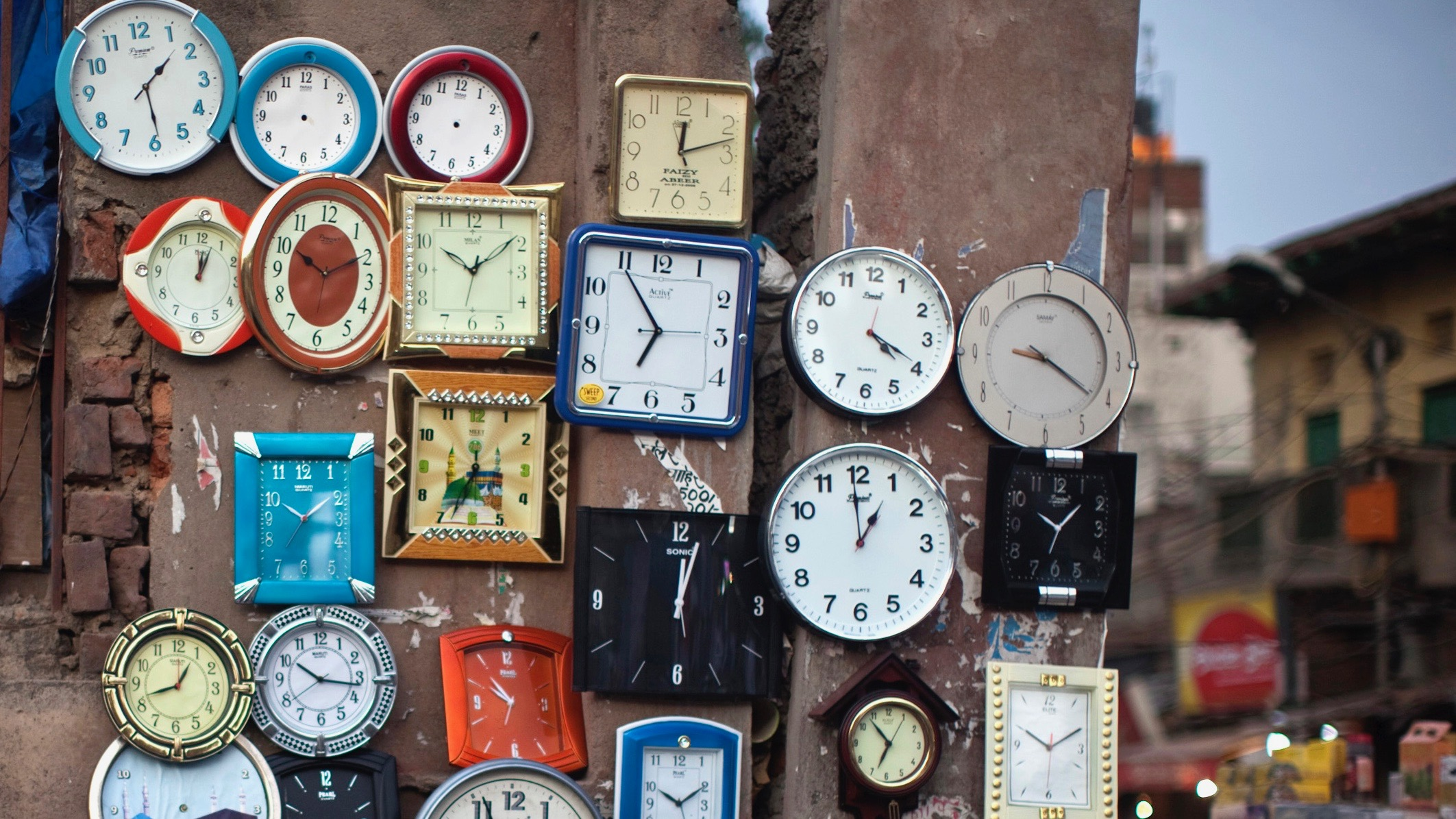 A wall of old clocks, India.